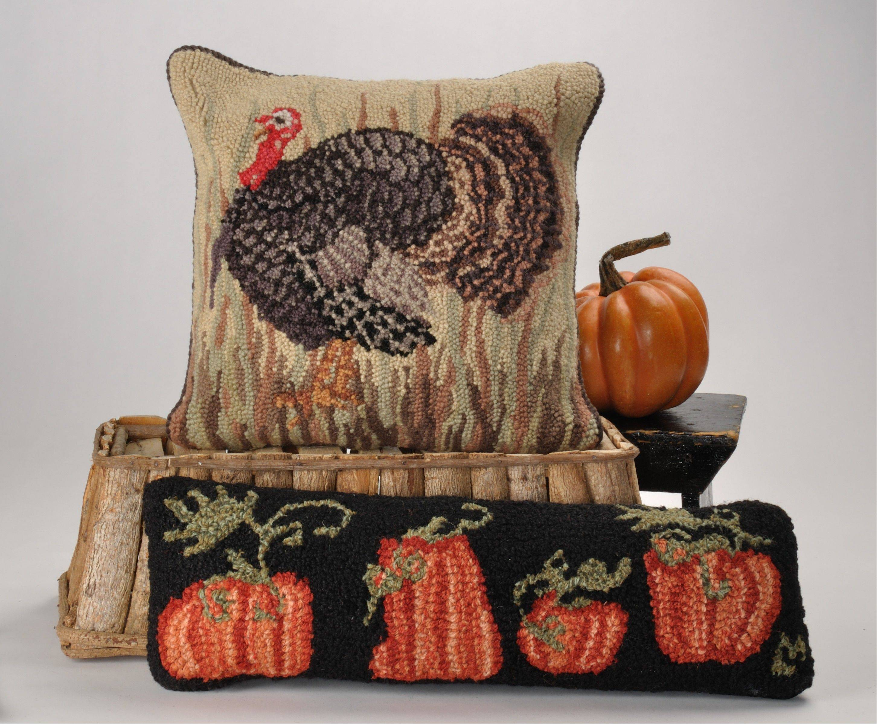 Graphic pillows add a soft, comfy feel to the fall decor.