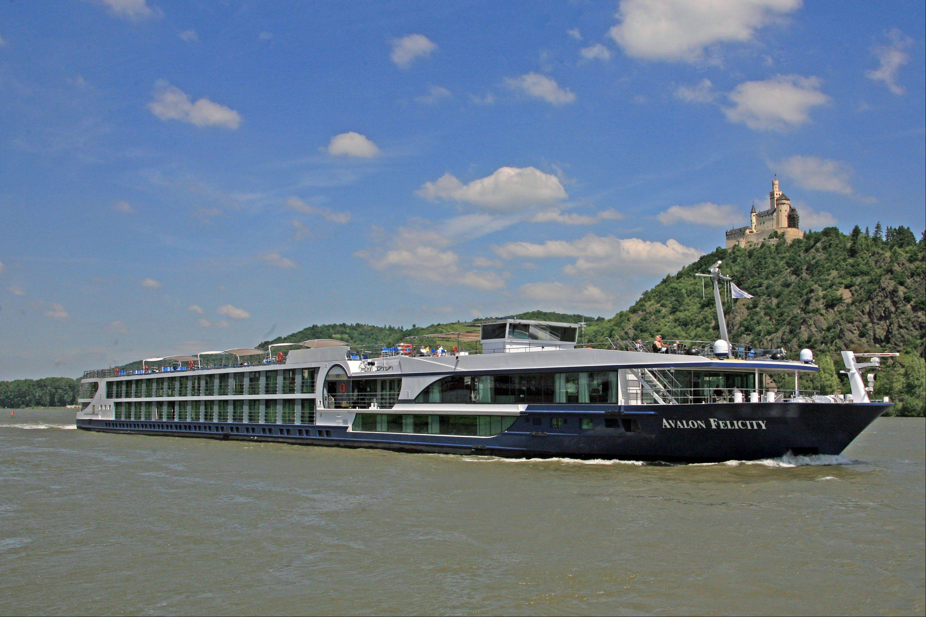 The river ship Avalon Felicity passes a castle on the Rhine River in Marksburg, Germany.