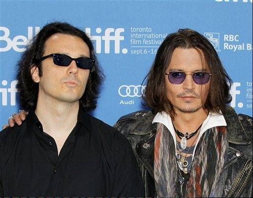 "Damien Echols, left, one of the West Memphis Three, and actor Johnny Depp at a press conference for the film ""West of Memphis"" at the 2012 Toronto International Film Festival in Toronto on Saturday."