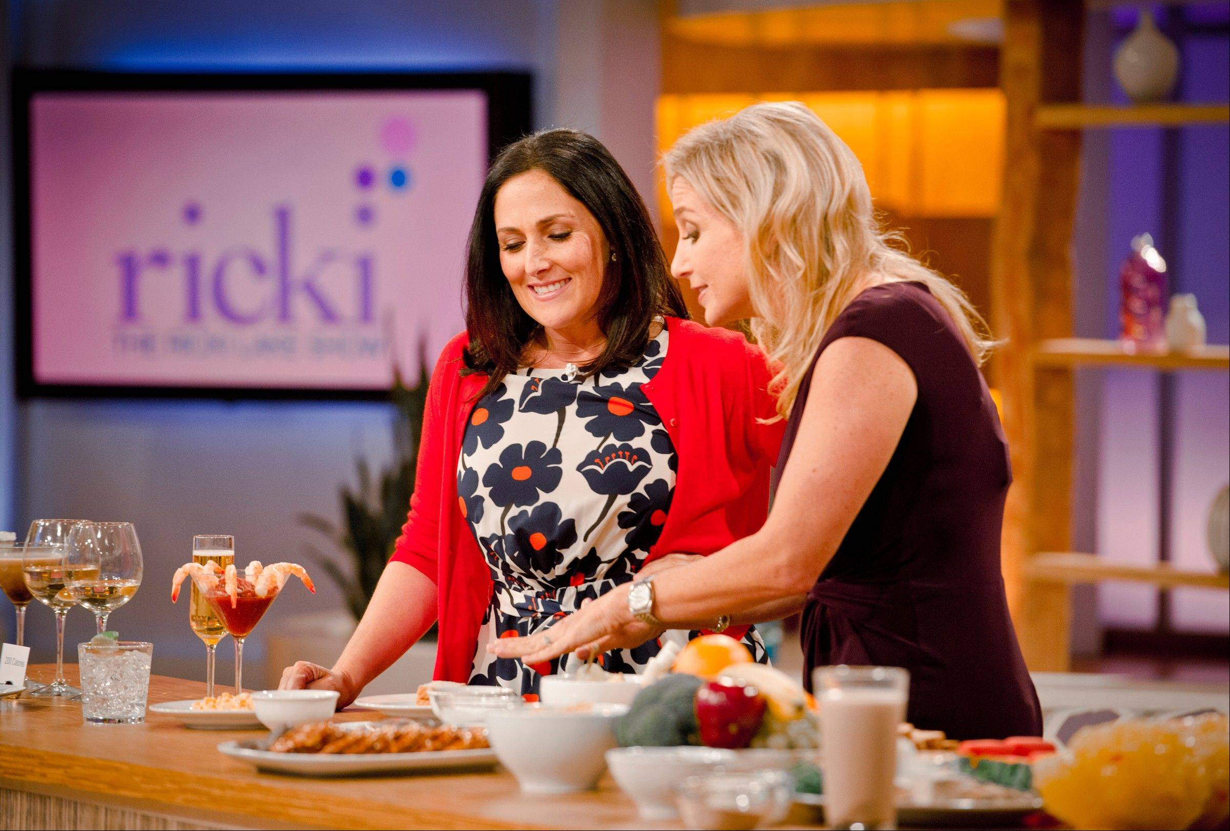 "Ricki Lake and physician nutrition specialist, Dr. Melina Jampolis, during the second day of taping for her new daytime talk show, ""The Ricki Lake Show."""