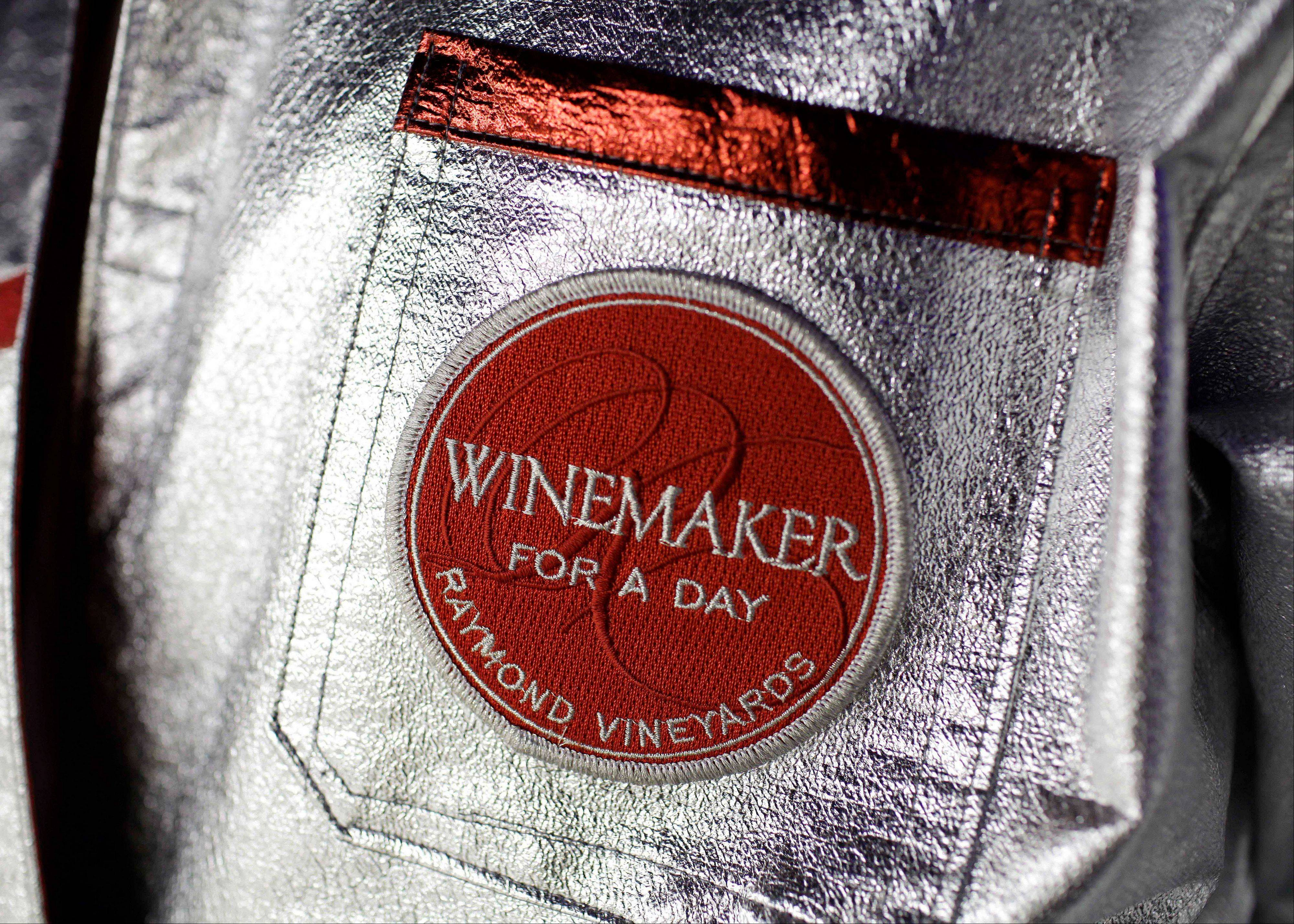 A patch on the lab coat of a participant taking part in the winemaker-for-a-day program at Raymond Vineyards.