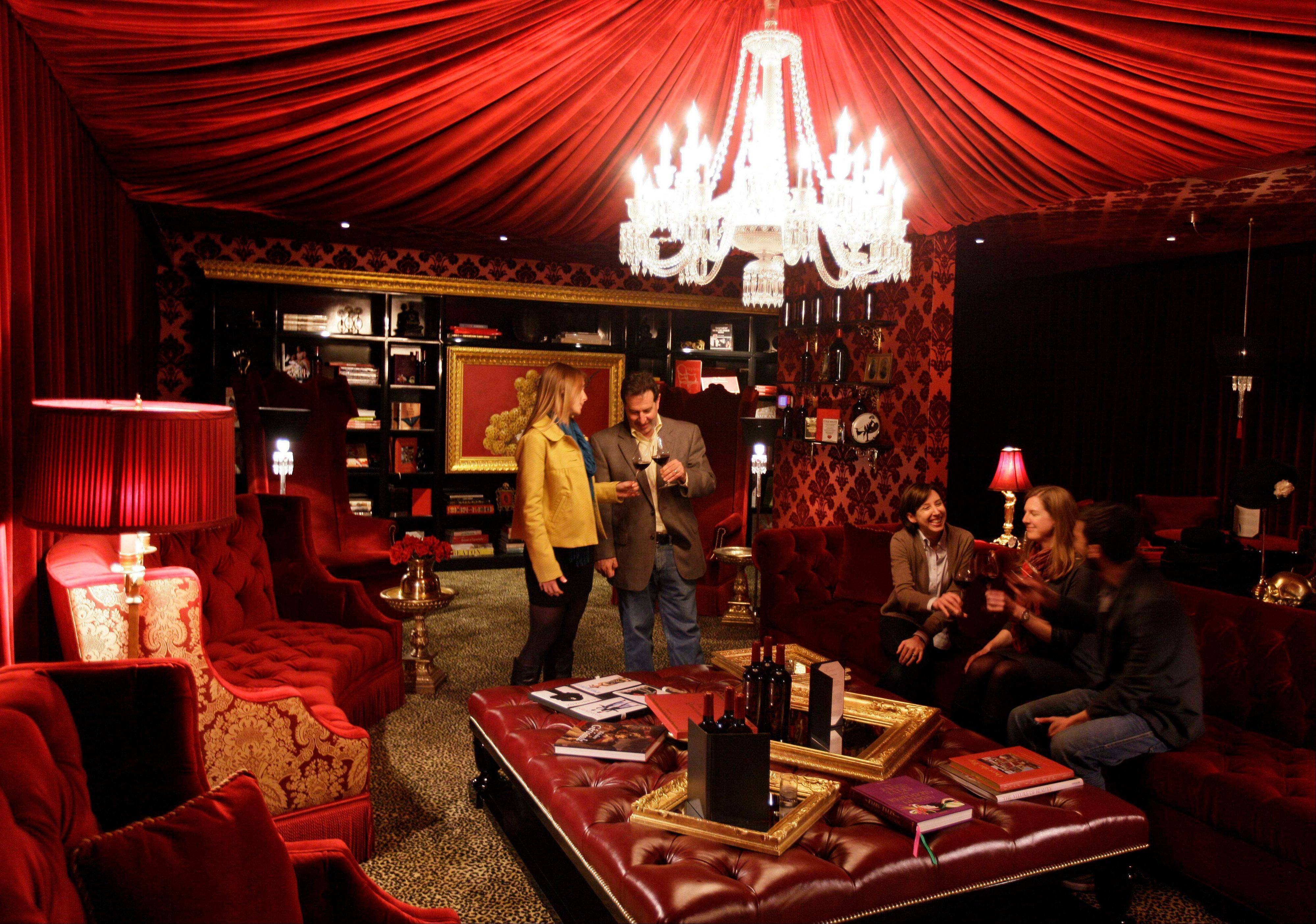 People taste wine in the Red Room at Raymond Vineyards in St. Helena, Calif. Under the guidance of Jean-Charles Boisset, scion of a French winemaking family who is married to Gina Gallo of the American Gallo wine dynasty, this winery has undergone a major change in recent years.