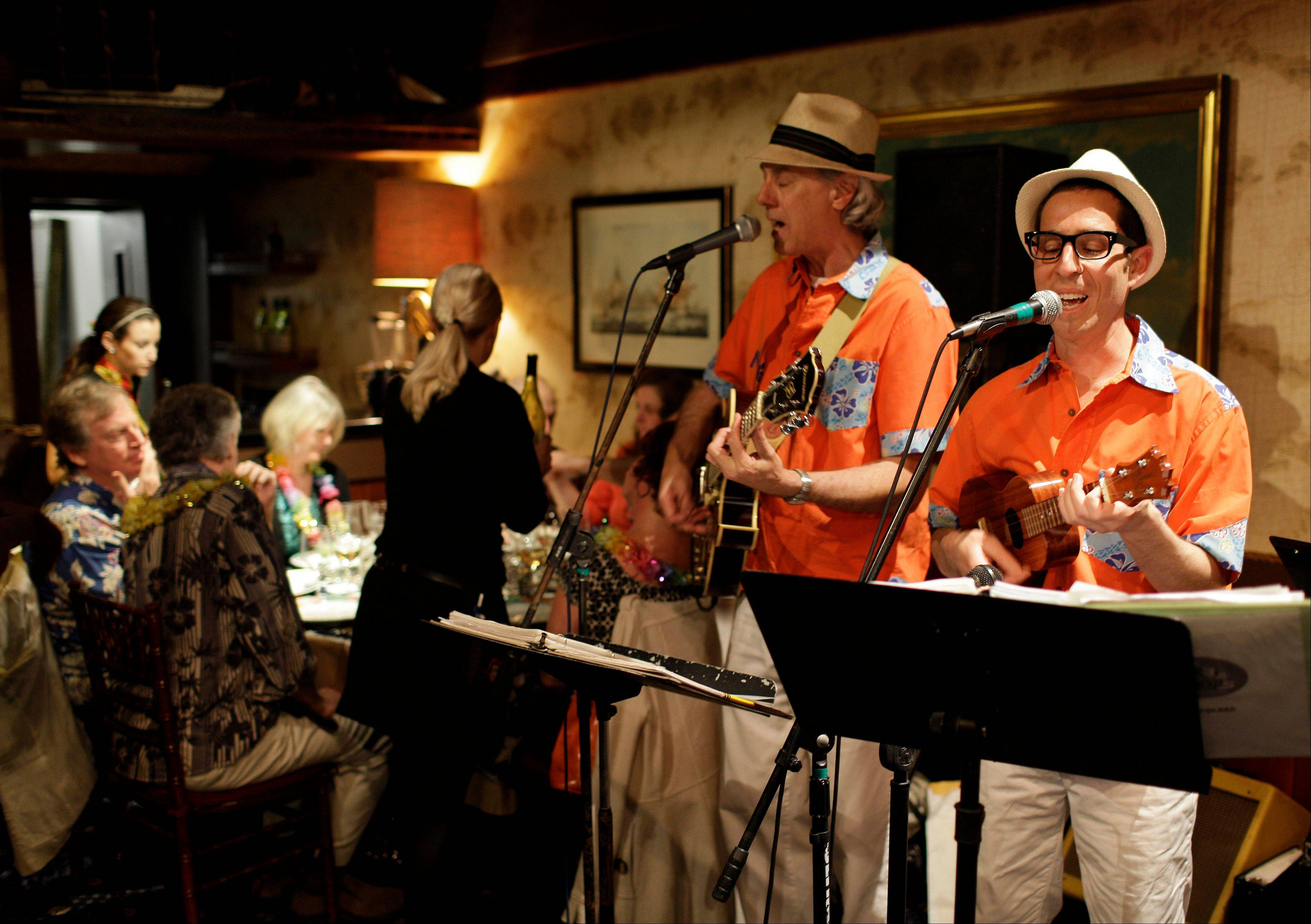 Winemaker Judd Finkelstein, right, of Judd's Hill winery, plays his ukulele with his band at Trader Vic's restaurant in Emeryville, Calif.