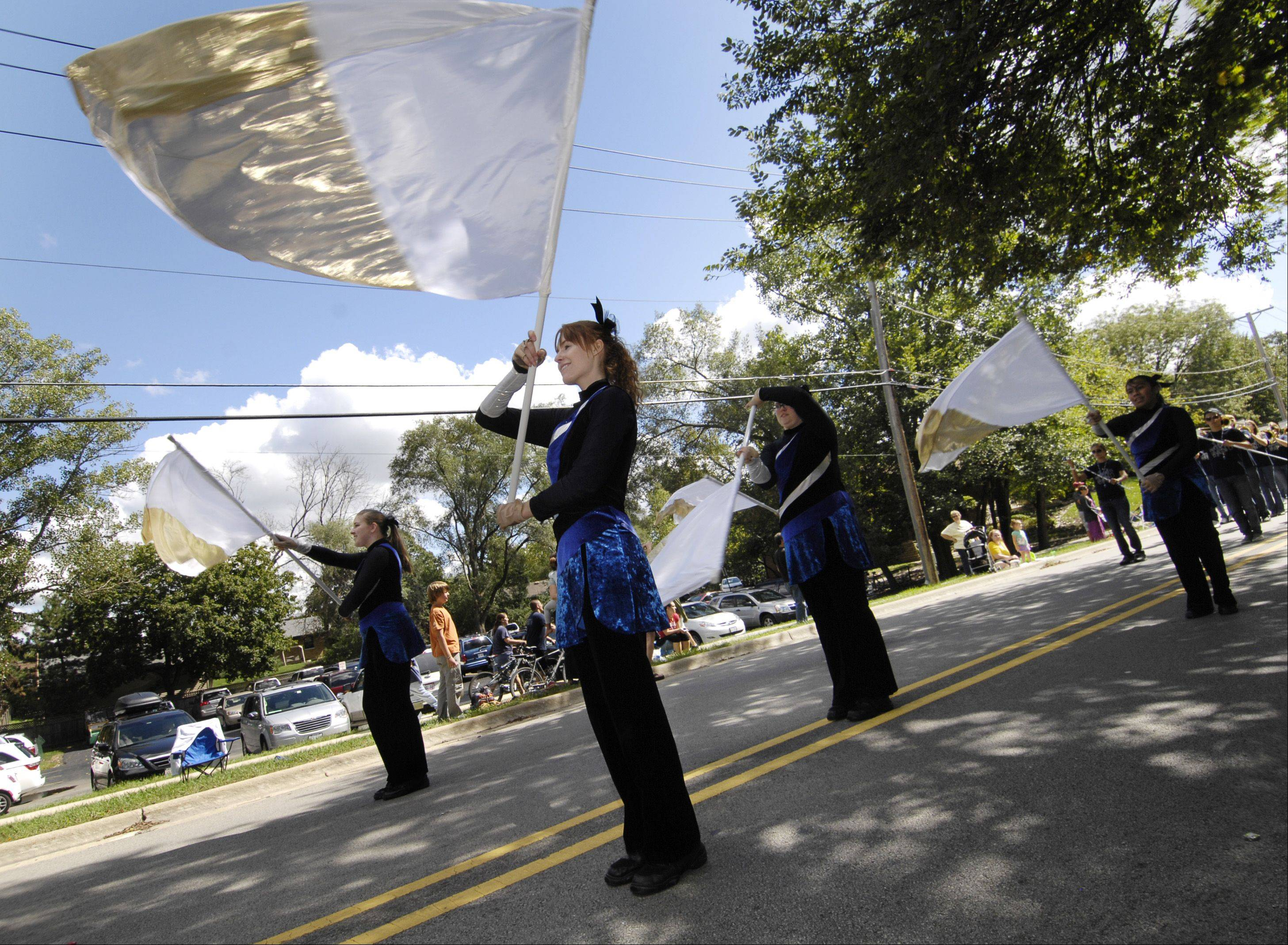 Members of Community High School flag team perform Sunday while marching in Winfield's Good Old Day festival parade.