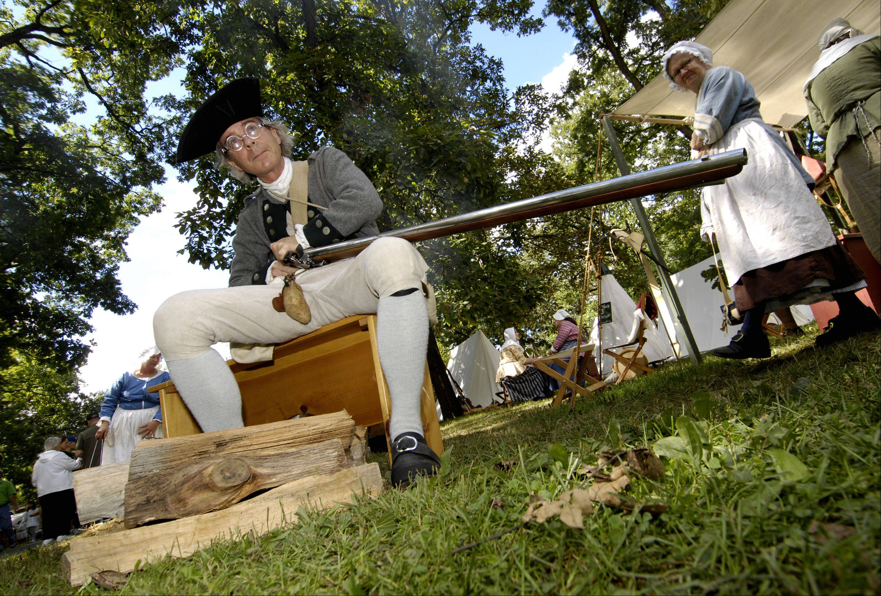 John Sutton, of Chicago, portrays a member of the Continental Army during a Revolutionary War re-enactment Sunday at Cantigny Park in Wheaton.