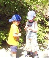 With exotic animals all around them during this visit to the zoo, best friends Carter Kettner, right, and Ben Keaty find the invading cicadas very fascinating.