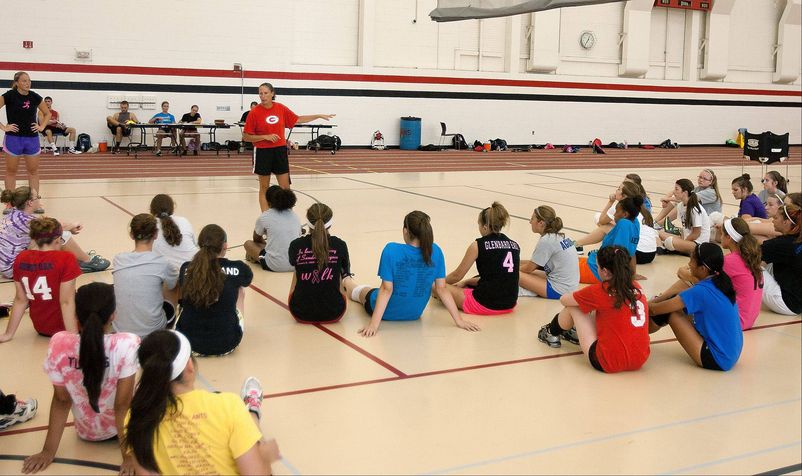 Girls and boys both participate in Glenbard East High School's summer volleyball camp run by coach Marci Maier. Students say the school offers equal athletic opportunities by running coed camps and allowing girls and boys both to practice with the other gender's team as volleyball trainers.