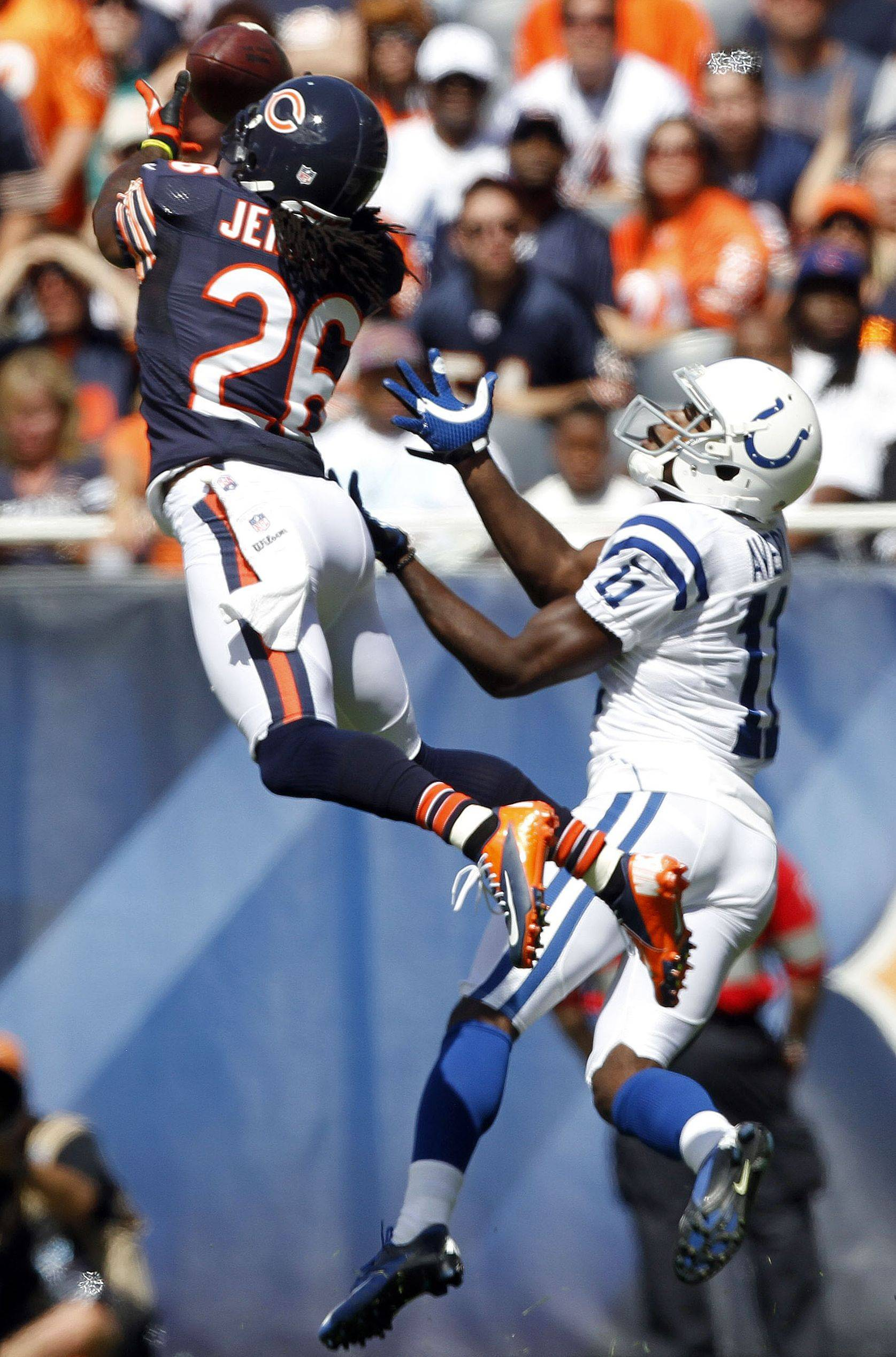 Cornerback Tim Jennings intercepts a pass intended for Colts wide receiver Donnie Avery on Sunday.