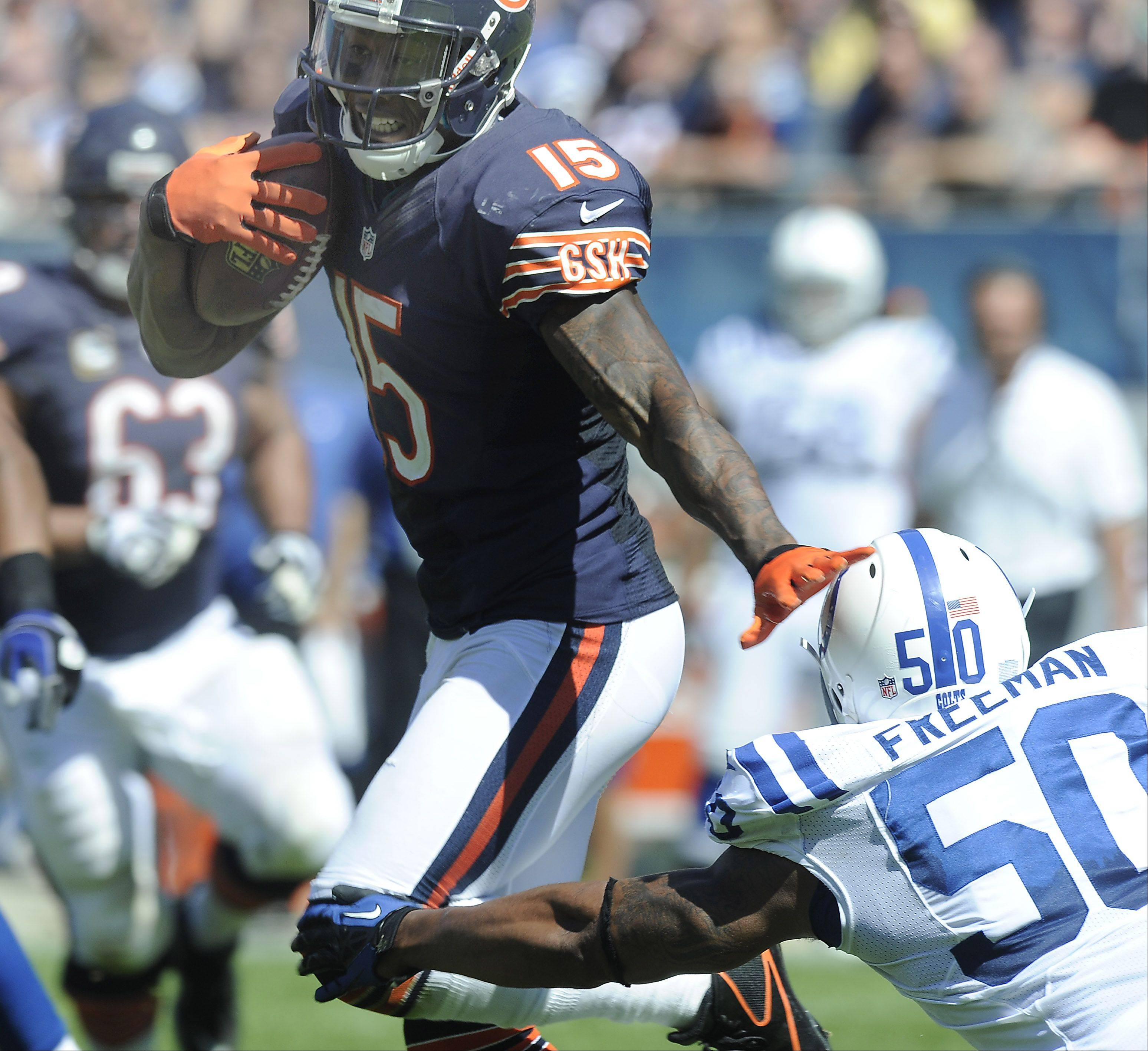 Bears wide receiver Brandon Marshall runs around Colts defender Jerrell Freeman on his way to 115 yards on 9 catches with a touchdown in Sunday's season-opening victory.