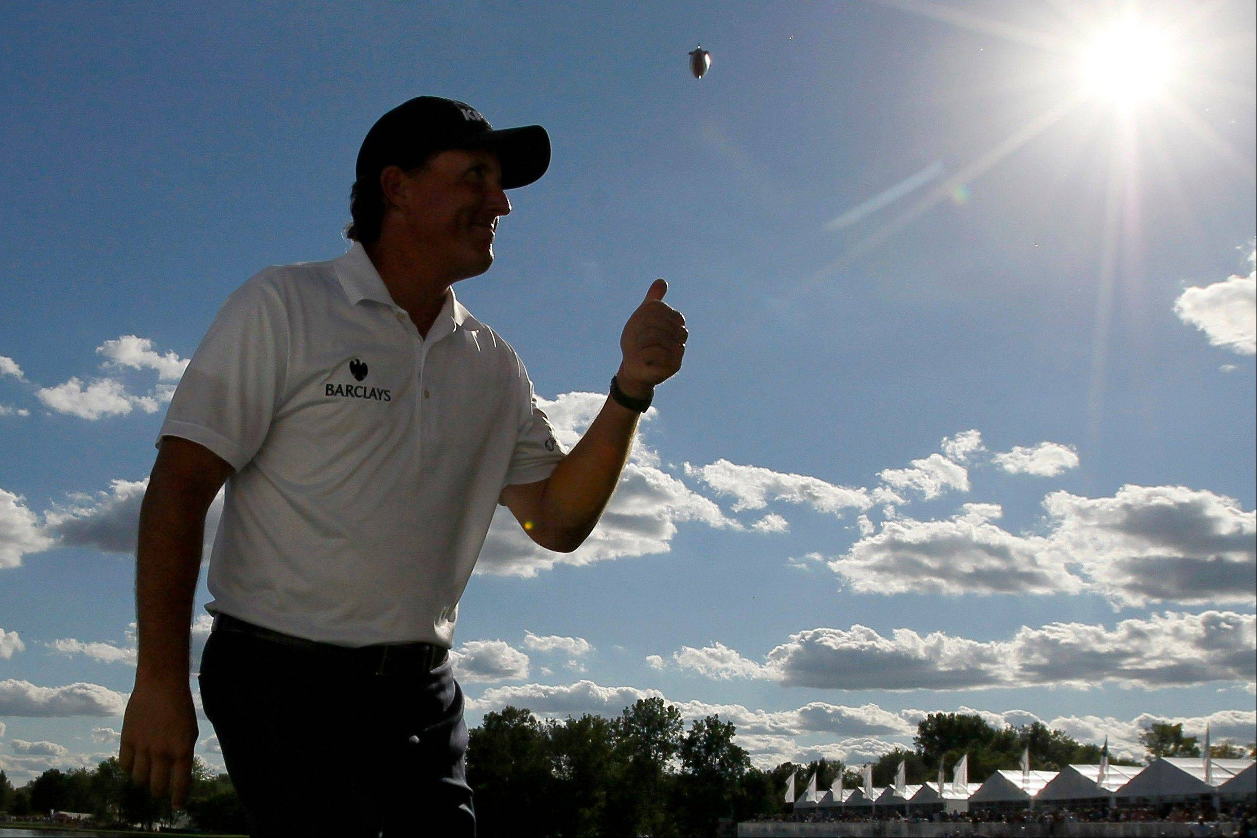 Phil Mickelson acknowledges the crowd with a thumbs-up after he birdied the 18th hole Saturday during the third round of the BMW Championship PGA golf tournament at Crooked Stick Golf Club in Carmel, Ind.