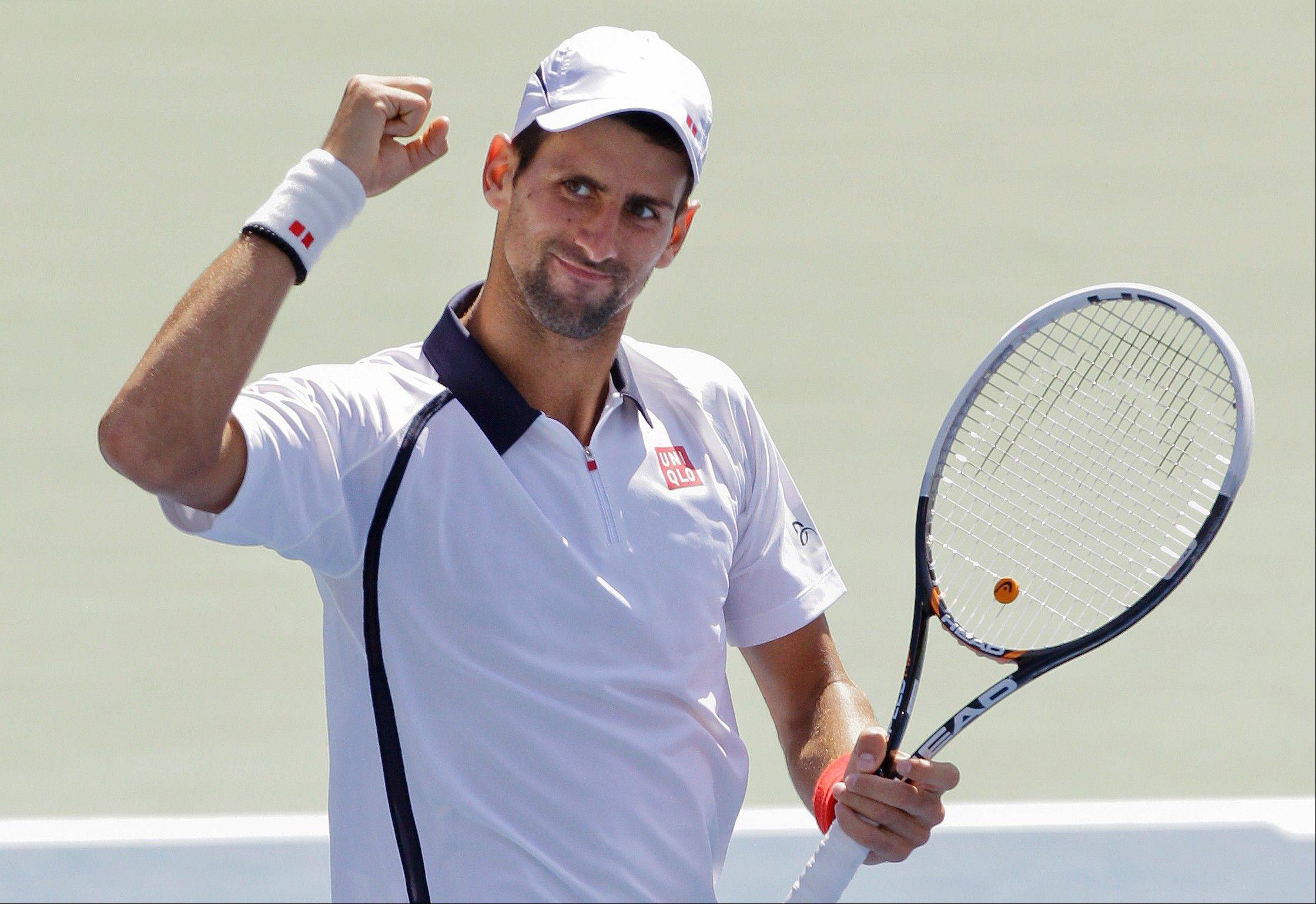Serbia's Novak Djokovic reacts Sunday after beating Spain's David Ferrer in a semifinal match at the 2012 US Open tennis tournament in New York.
