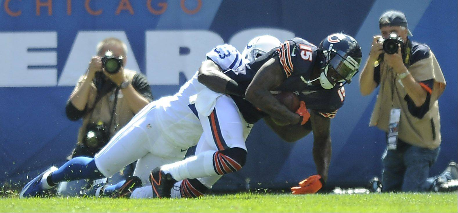 Chicago Bears Brandon Marshall scores a second-quarter touchdown despite pressure from Colts Vontae Davis in the Bears home opener at Soldier Field in Chicago.