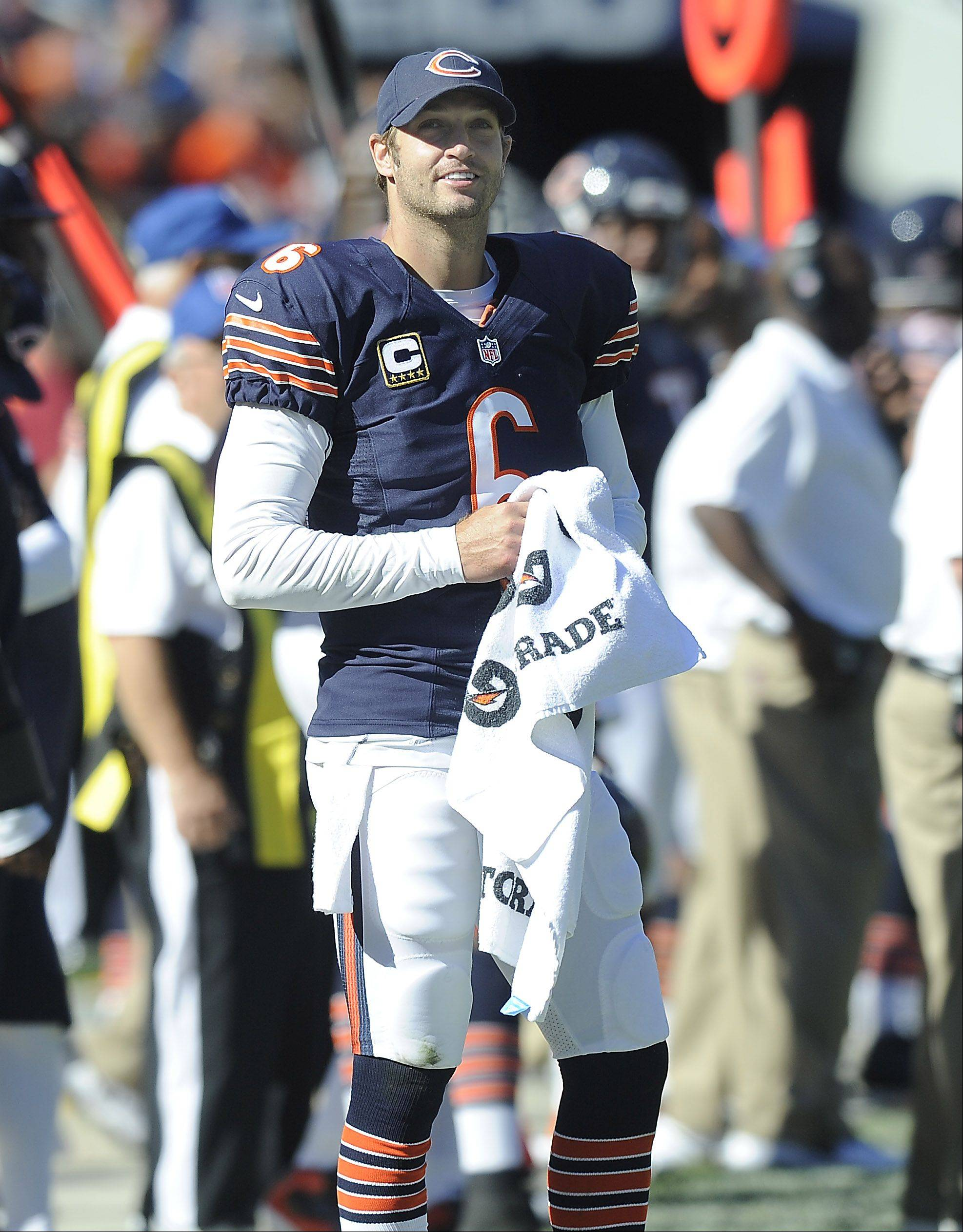 Chicago Bears quarterback Jay Cutler is all smiles as he looks to the scoreboard late in the 4th quarter during the Bears home opener against the Colts at Soldier Field in Chicago.