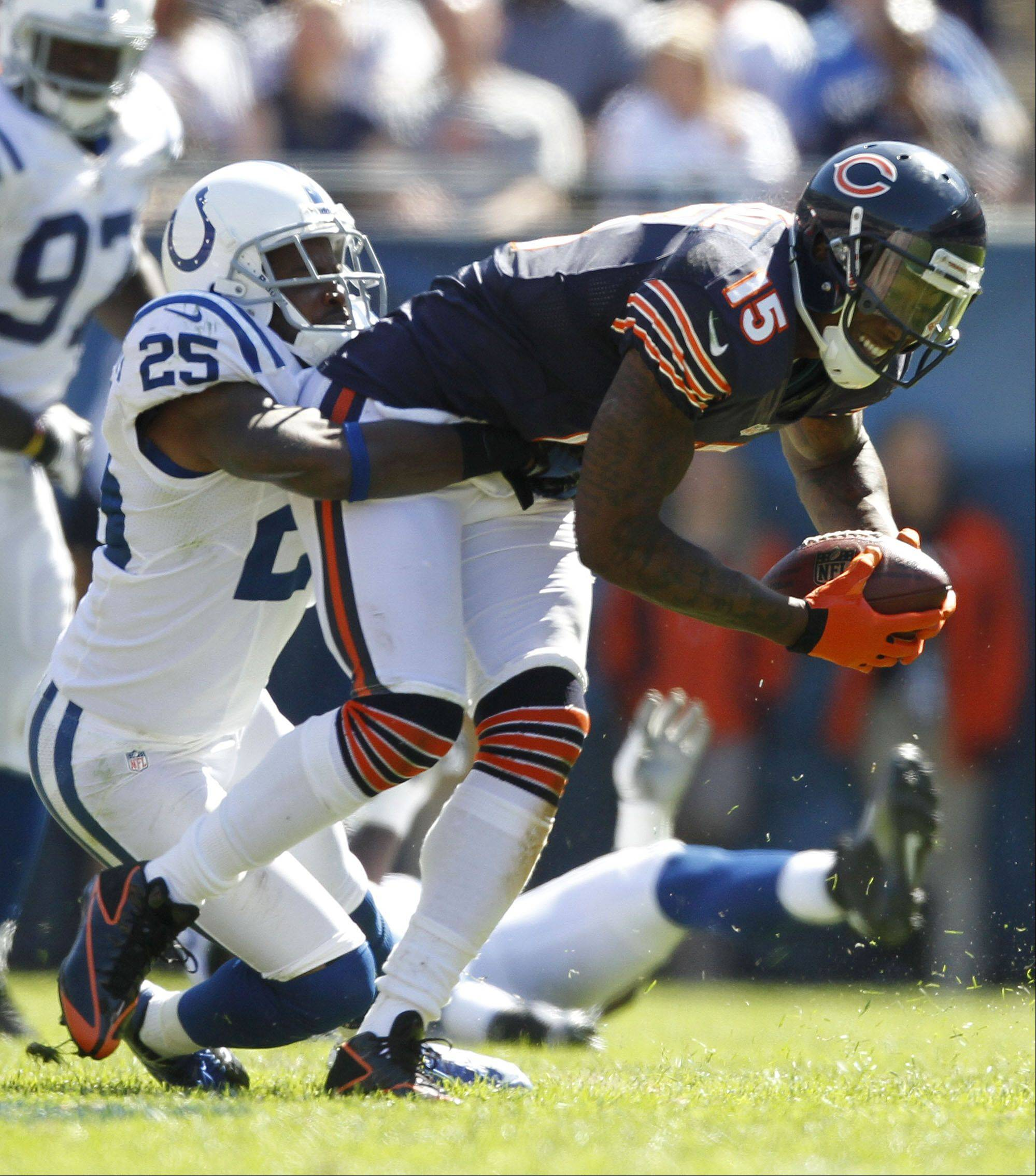 Chicago Bears wide receiver Brandon Marshall tries to escape the grasp of Indianapolis Colts cornerback Jerraud Powers during the Bears season opener.
