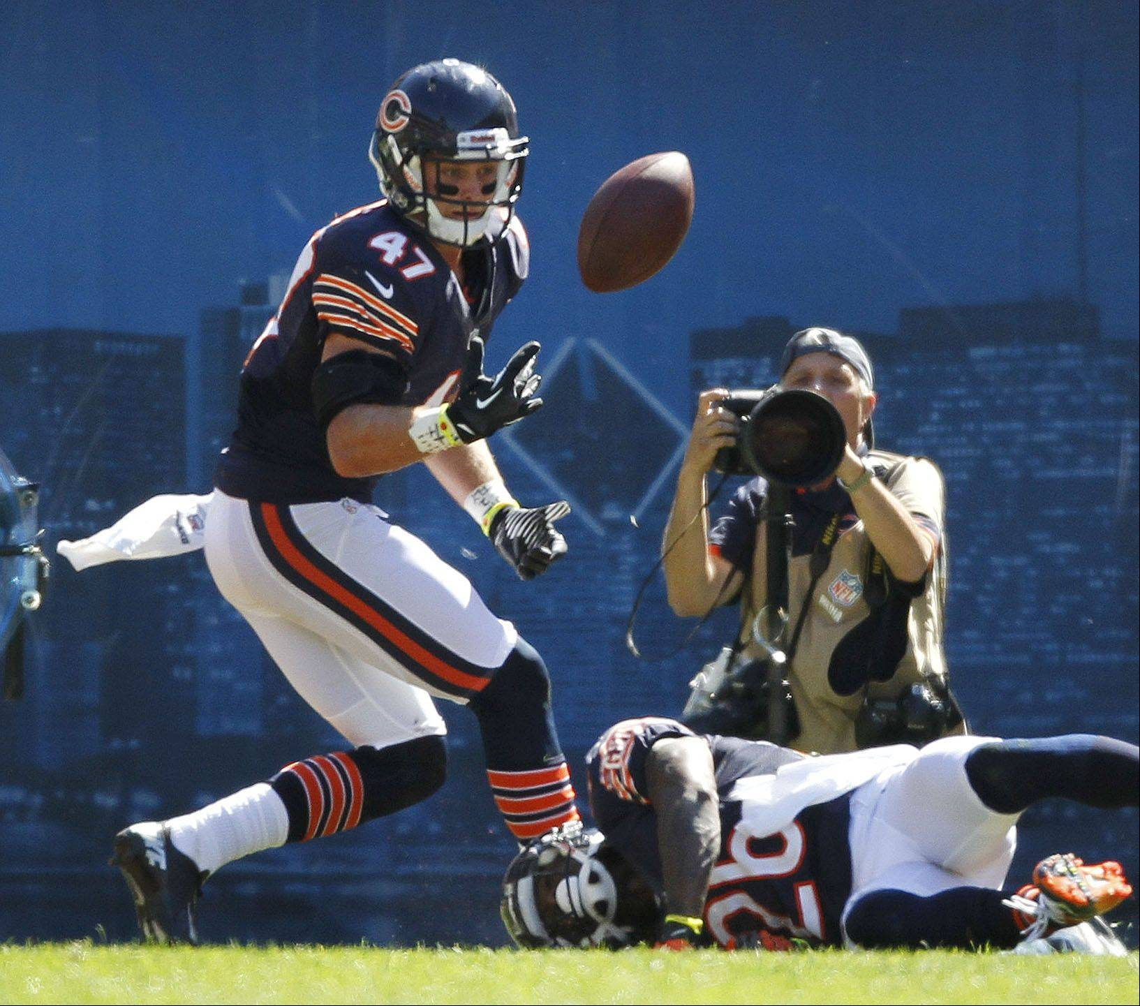 Chicago Bears free safety Chris Conte makes an interception in the endzpne after the play was broken up by Chicago Bears cornerback Tim Jennings during the Bears season opener.