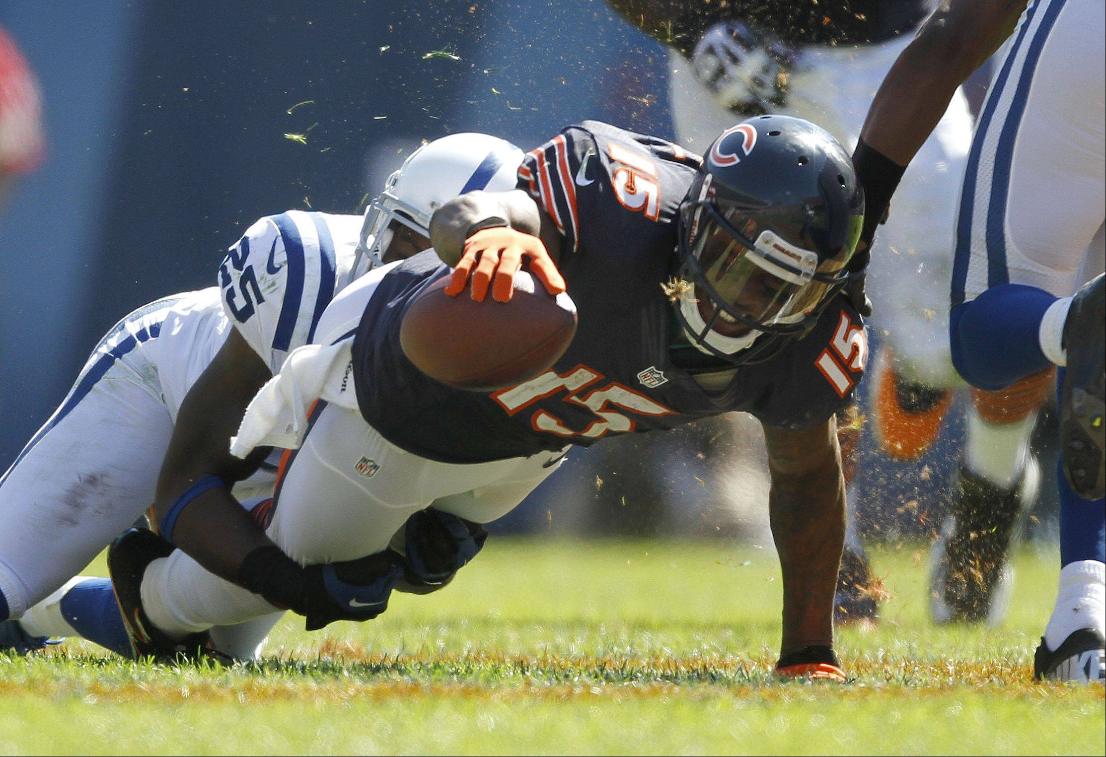 Chicago Bears wide receiver Brandon Marshall stretches for the first down marker during the Bears season opener.