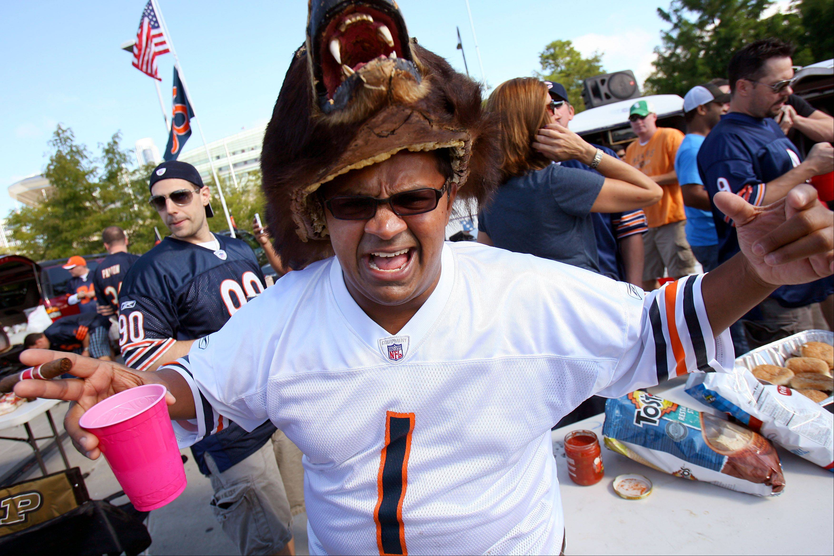 Sal Kahn of Naperville sports a bear hat as he tailgates on the Waldron Deck before the Bears season opener against the Indianapolis Colts Sunday at Soldier Field in Chicago.