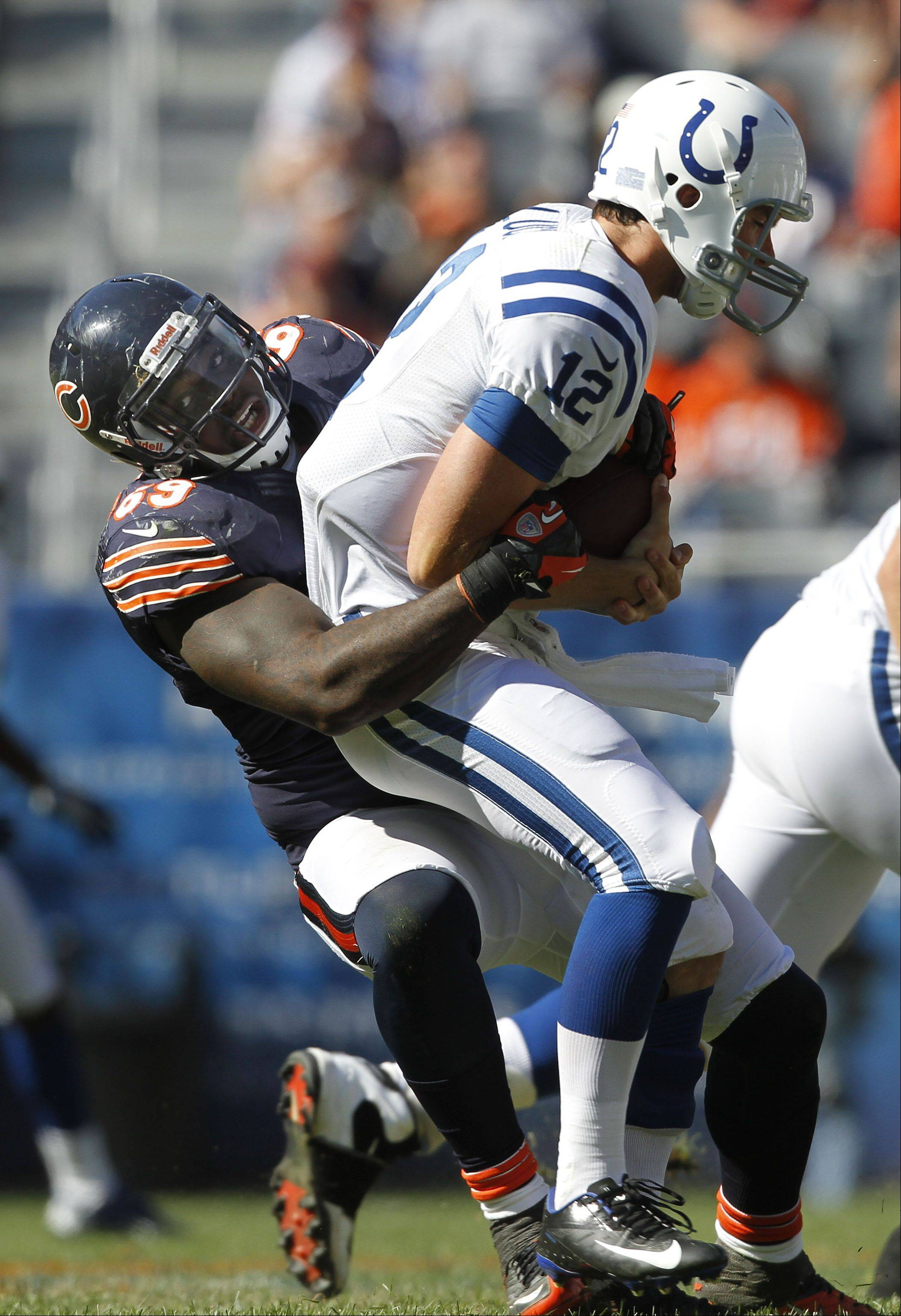Chicago Bears defensive end Henry Melton sacks Indianapolis Colts quarterback Andrew Luck during the Bears season opener against the Indianapolis Colts Sunday at Soldier Field in Chicago. The Bears won 41-21
