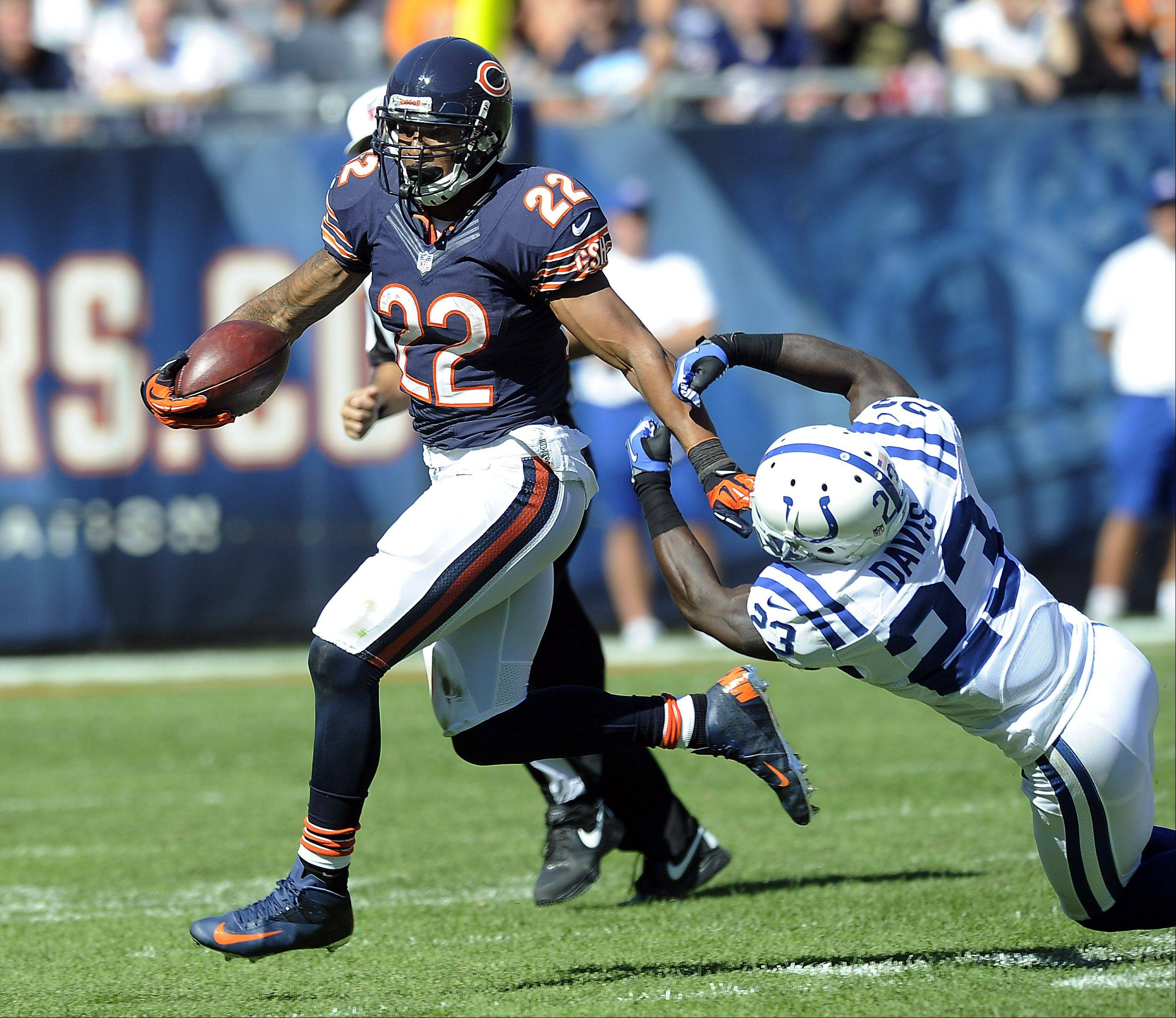 Chicago Bears running back Michael Bush looks for running room during the Bears season opener.