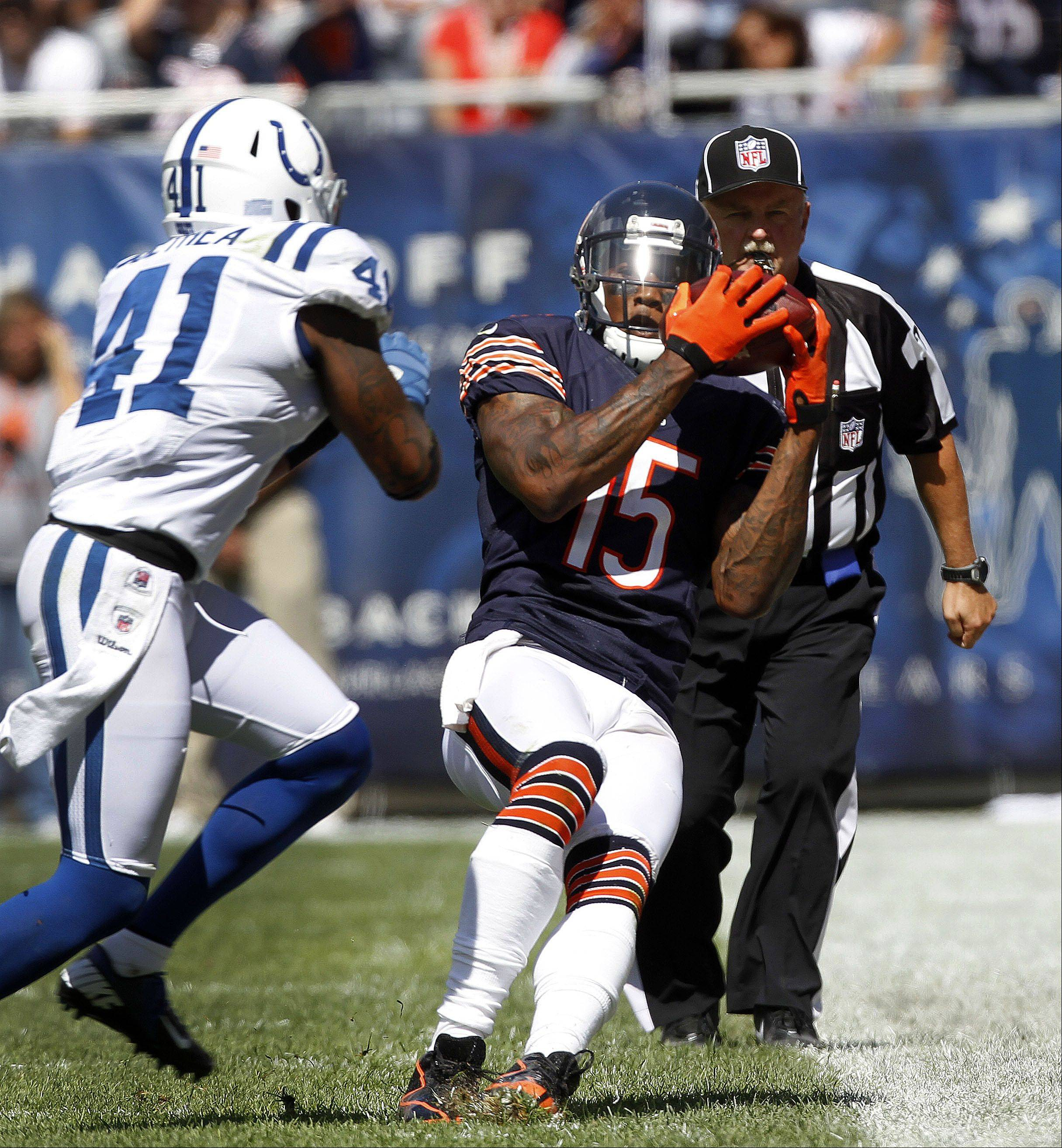 Chicago Bears wide receiver Brandon Marshall makes a sideline catch during the Bears season opener.