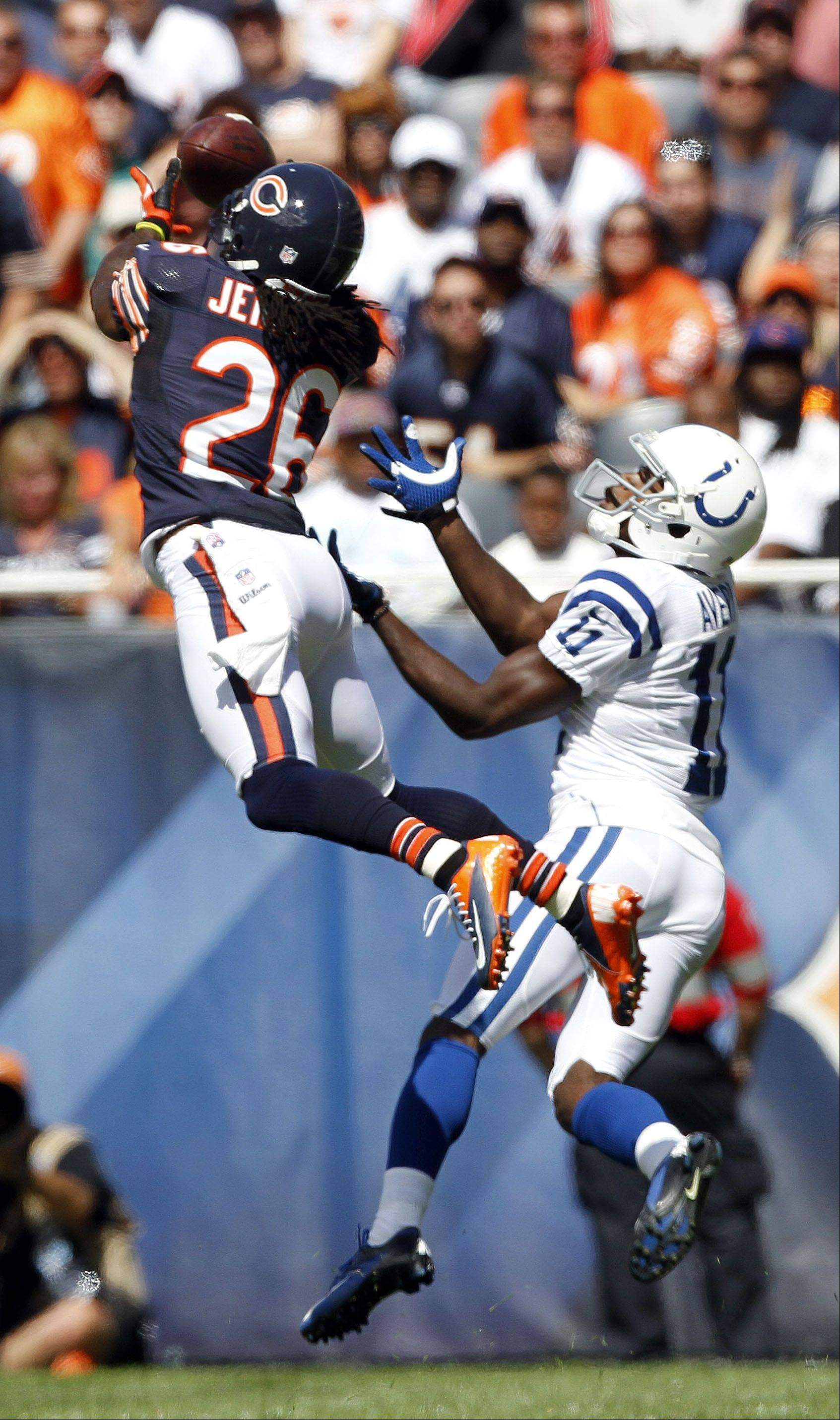 Chicago Bears cornerback Tim Jennings comes up with an interception on Indianapolis Colts wide receiver Donnie Avery during the Bears season opener.