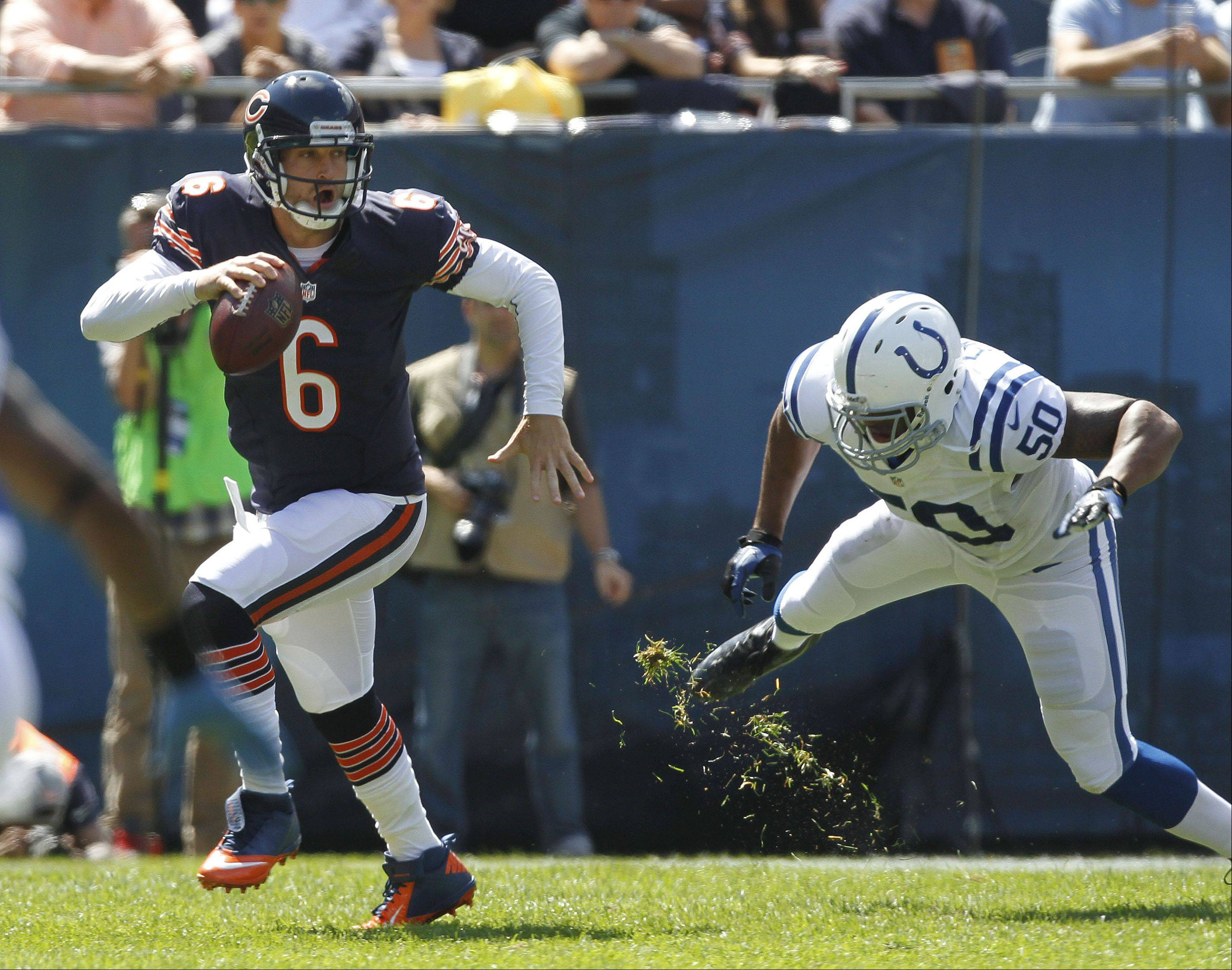 Chicago Bears quarterback Jay Cutler scrambles to get away from Indianapolis Colts linebacker Jerrell Freeman during the Bears season opener.