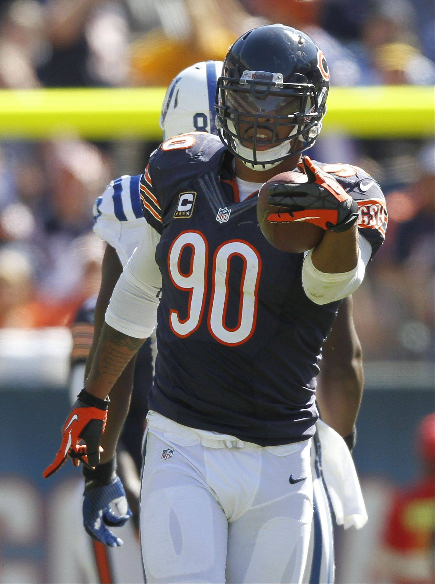 Chicago Bears defensive end Julius Peppers celebrates after recovering a fumble during the Bears season opener.