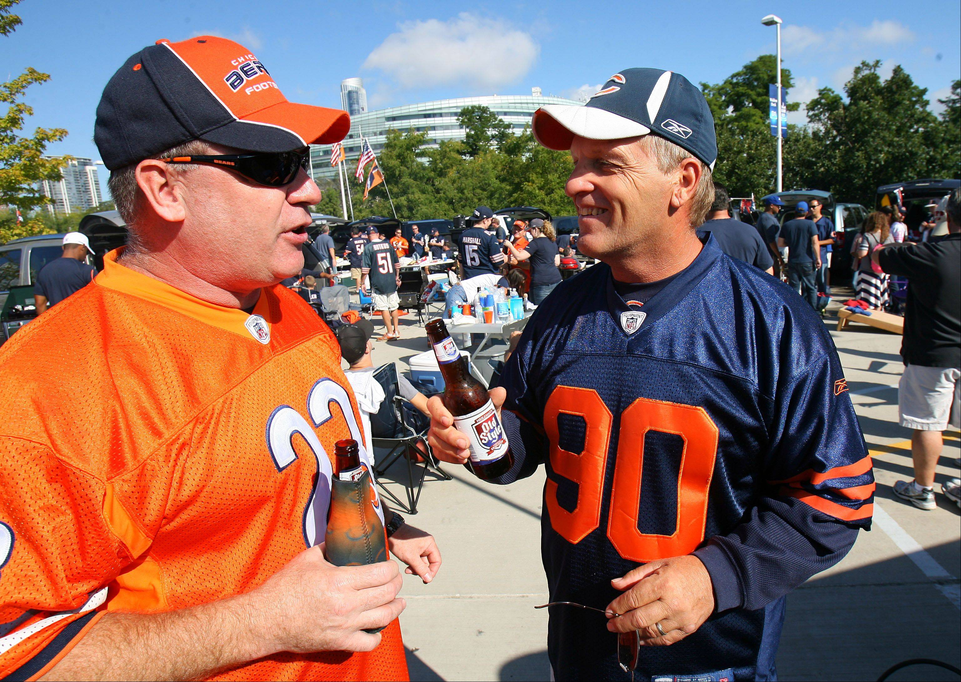 Terry Normoyle of St. Charles and Duane Schmitt of Burlington tailgate on the Waldron Deck before the Bears season opener against the Indianapolis Colts Sunday at Soldier Field in Chicago.