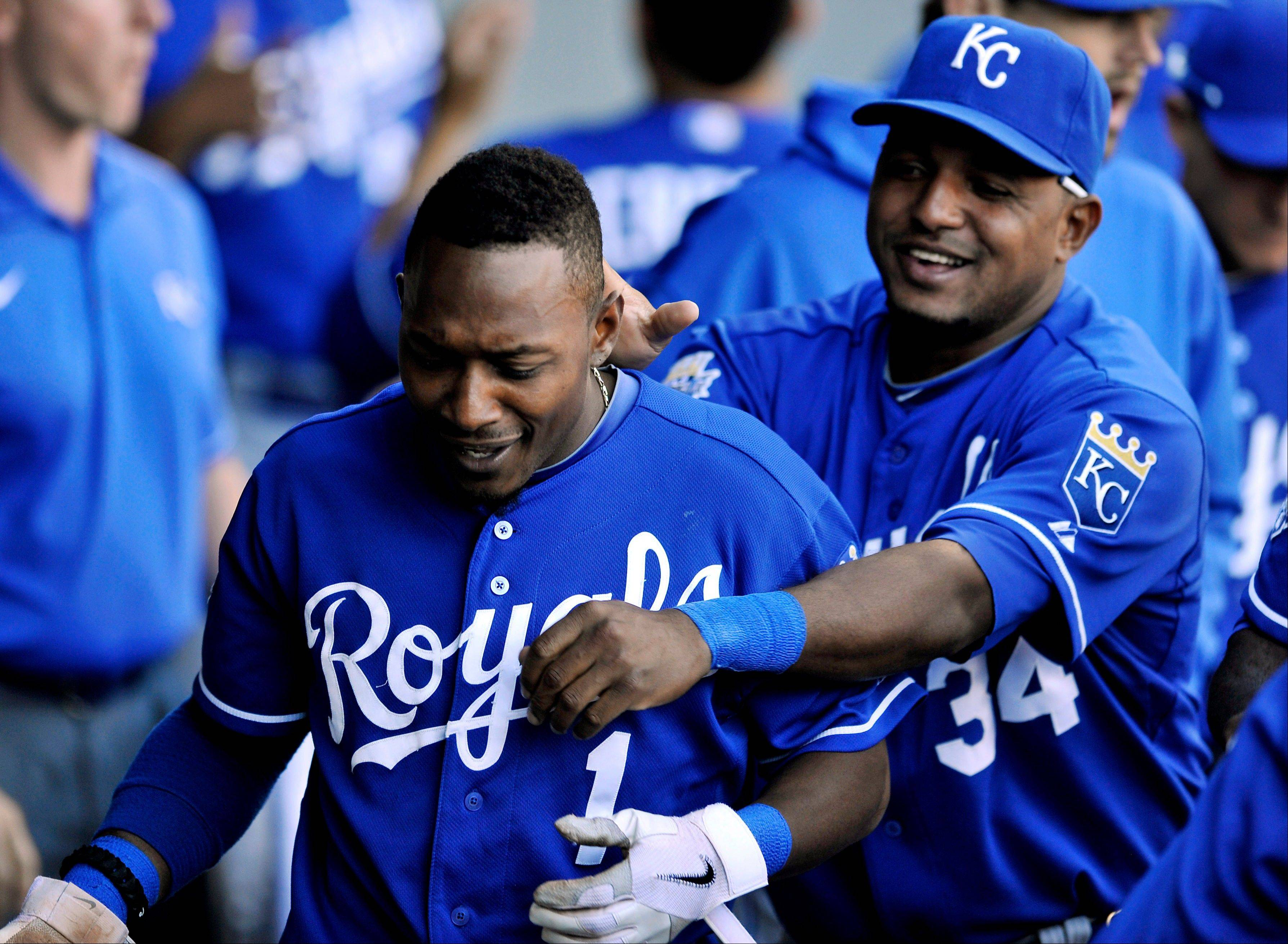 Kansas City Royals' Jarrod Dyson left, celebrates with Tony Abreu right, in the dugout after scoring on a single hit by Mike Moustakas in the 10th inning during a baseball game against the Chicago White Sox in Chicago, Sunday, Sept. 9, 2012. Kansas City won 2-1 in ten innings.