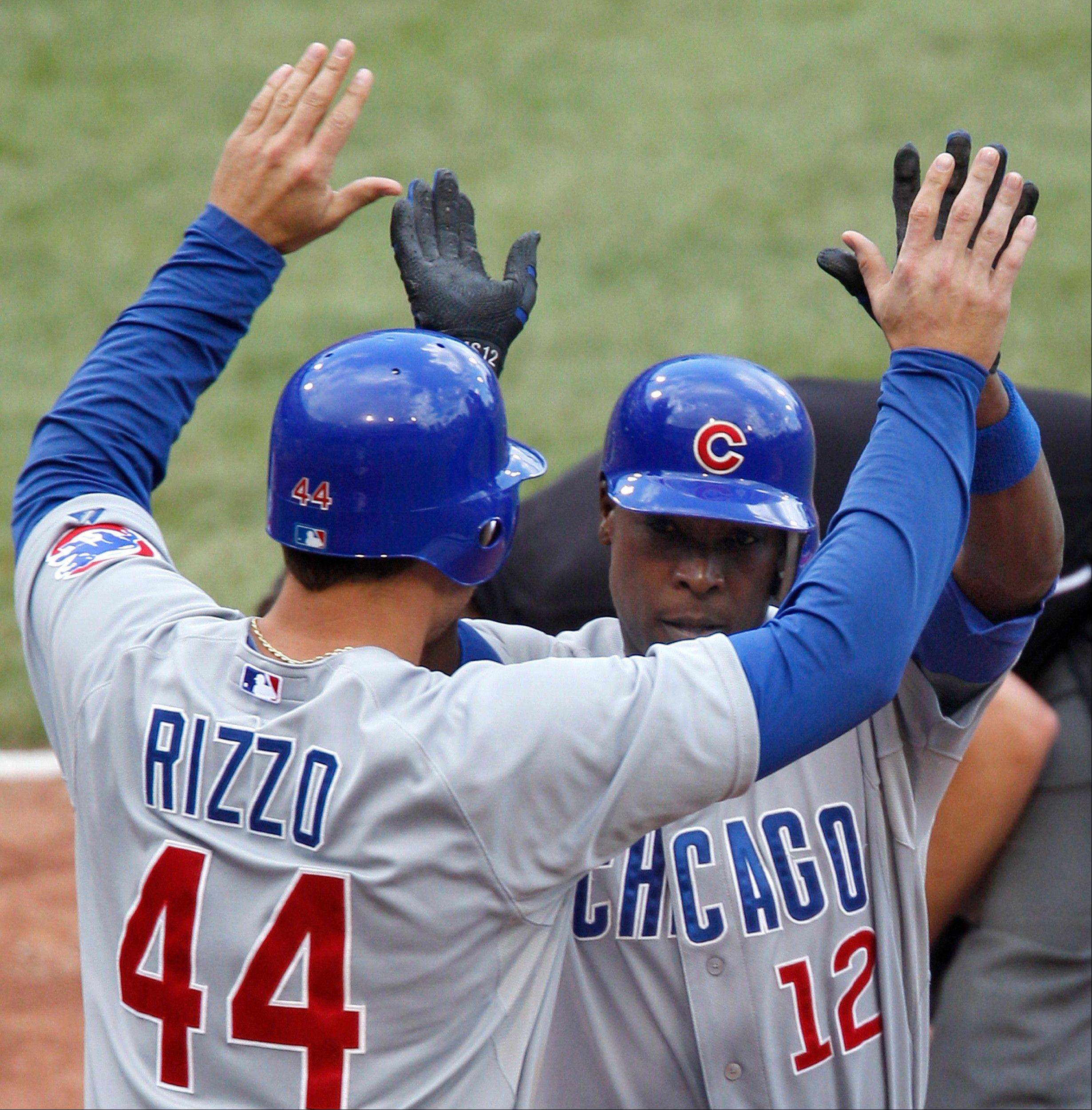 Cubs outfielder Alfonso Soriano and Anthony Rizzo celebrate after Soriano drove in them both with a two-run home run in the eighth inning Sunday at PNC Park.