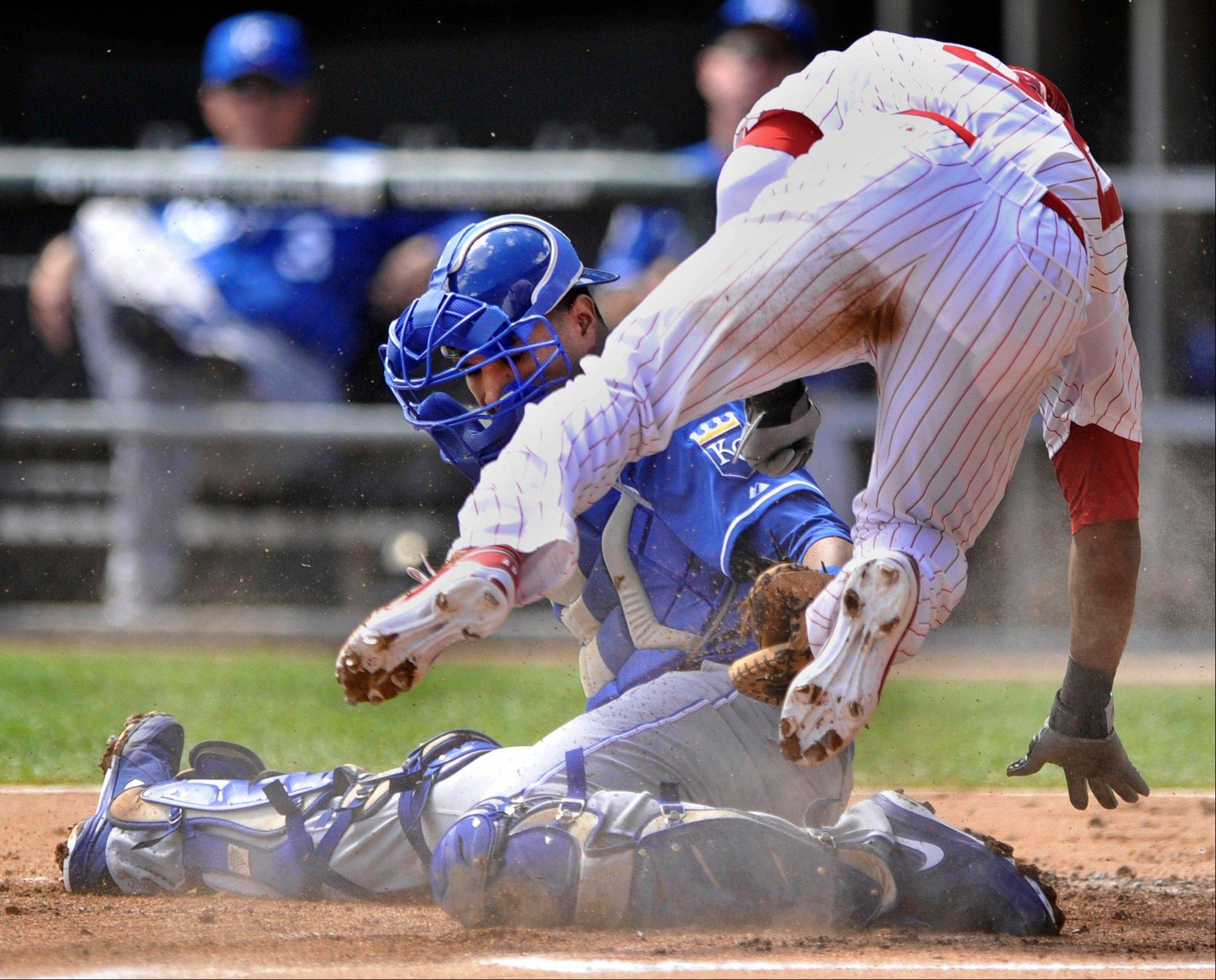Kansas City Royals catcher Salvador Perez, left, tags out the White Sox' Alejandro De Aza, right, at home plate after De Aza tagged up at third base on a Dewayne Wise pop-up in Sunday's first inning at U.S. Cellular Field.