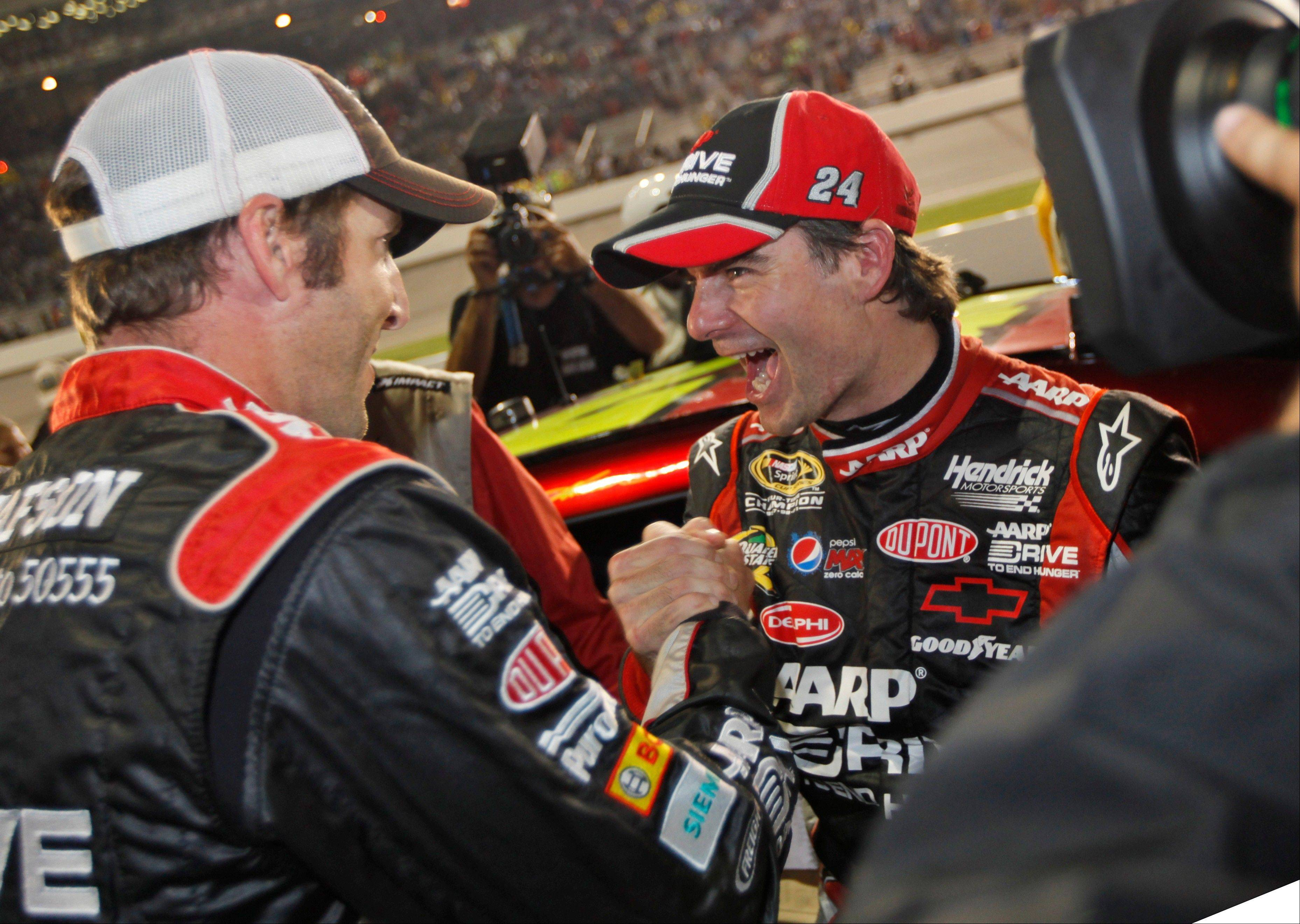 Jeff Gordon celebrates making the chase with crew chief, Alan Gustafson, left, on pit row after the NASCAR Sprint Cup Series auto race at the Richmond International Raceway in Richmond, Va., Sunday, Sept. 9, 2012.
