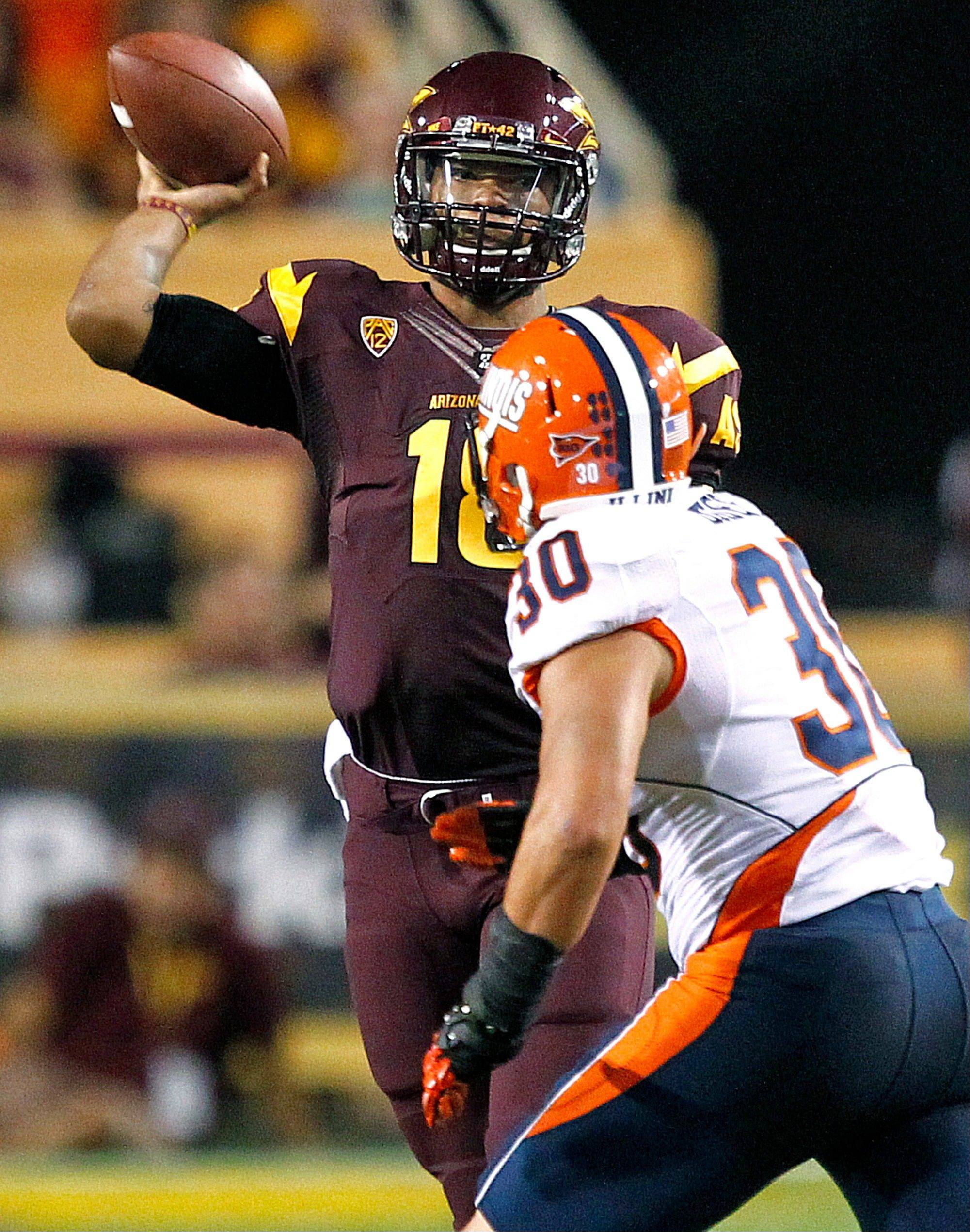 Arizona State quarterback Michael Eubank throws over Illinois linebacker Houston Bates during Saturday's first half in Tempe, Ariz.