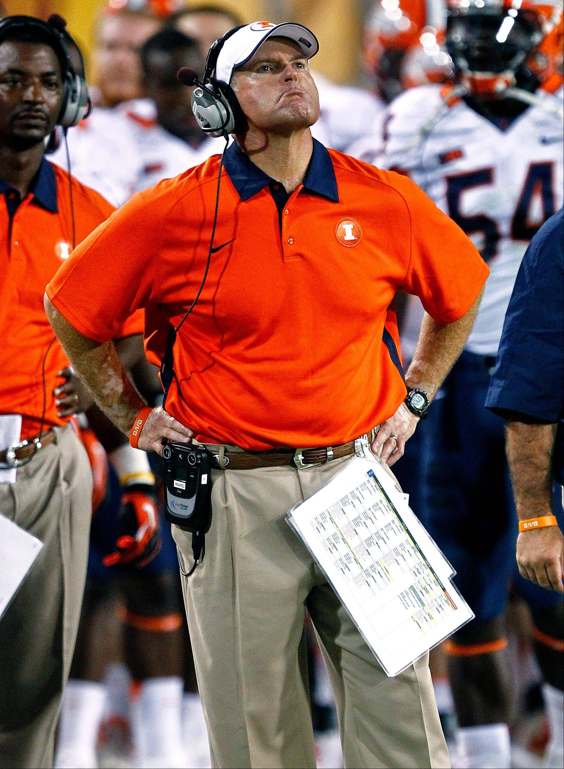 Illinois head coach Tim Beckman looks at the scoreboard during Saturday's first half in Tempe, Ariz.