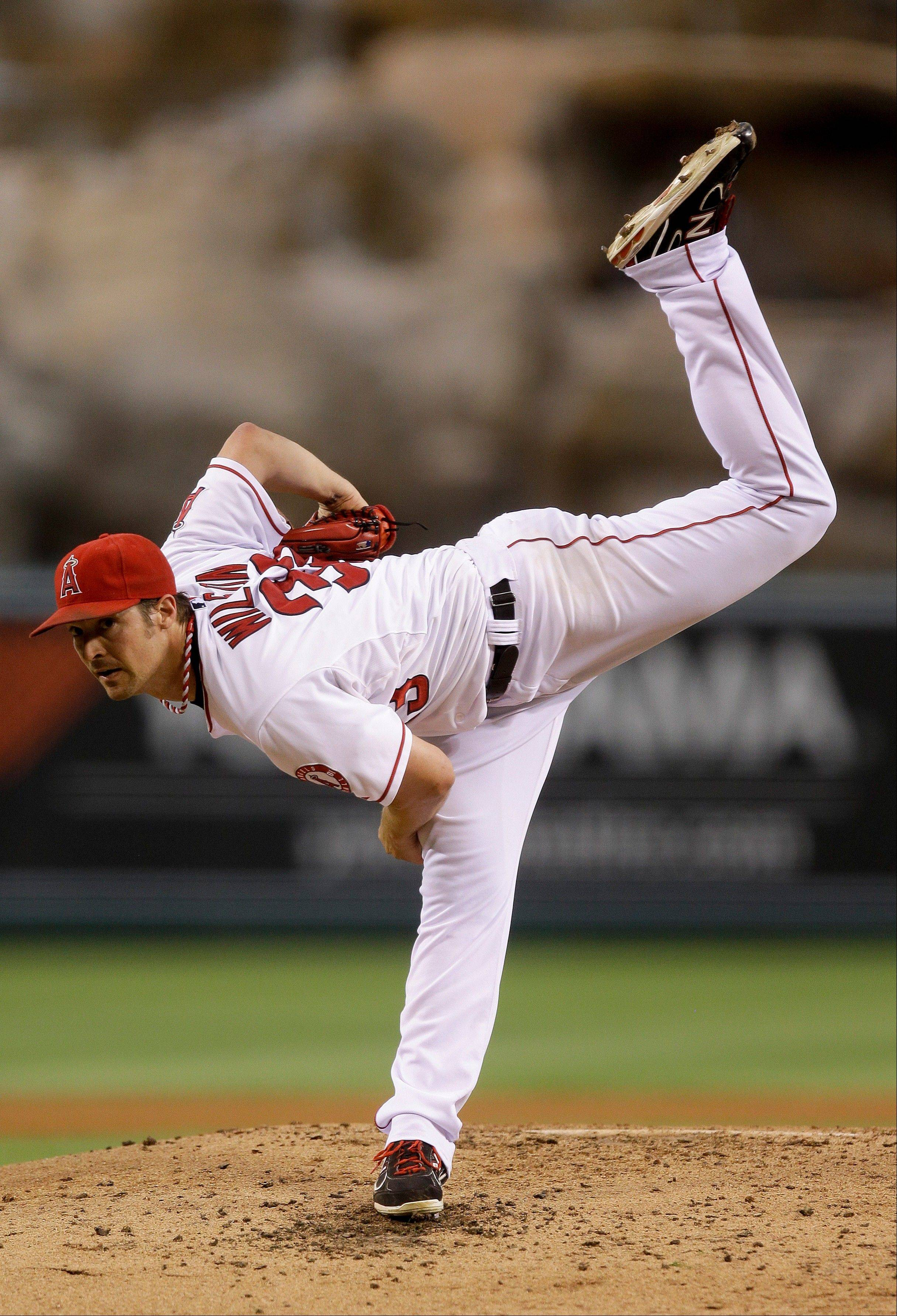 Angels starting pitcher C.J. Wilson throws to the Detroit Tigers during the fourth inning Saturday in Anaheim, Calif.