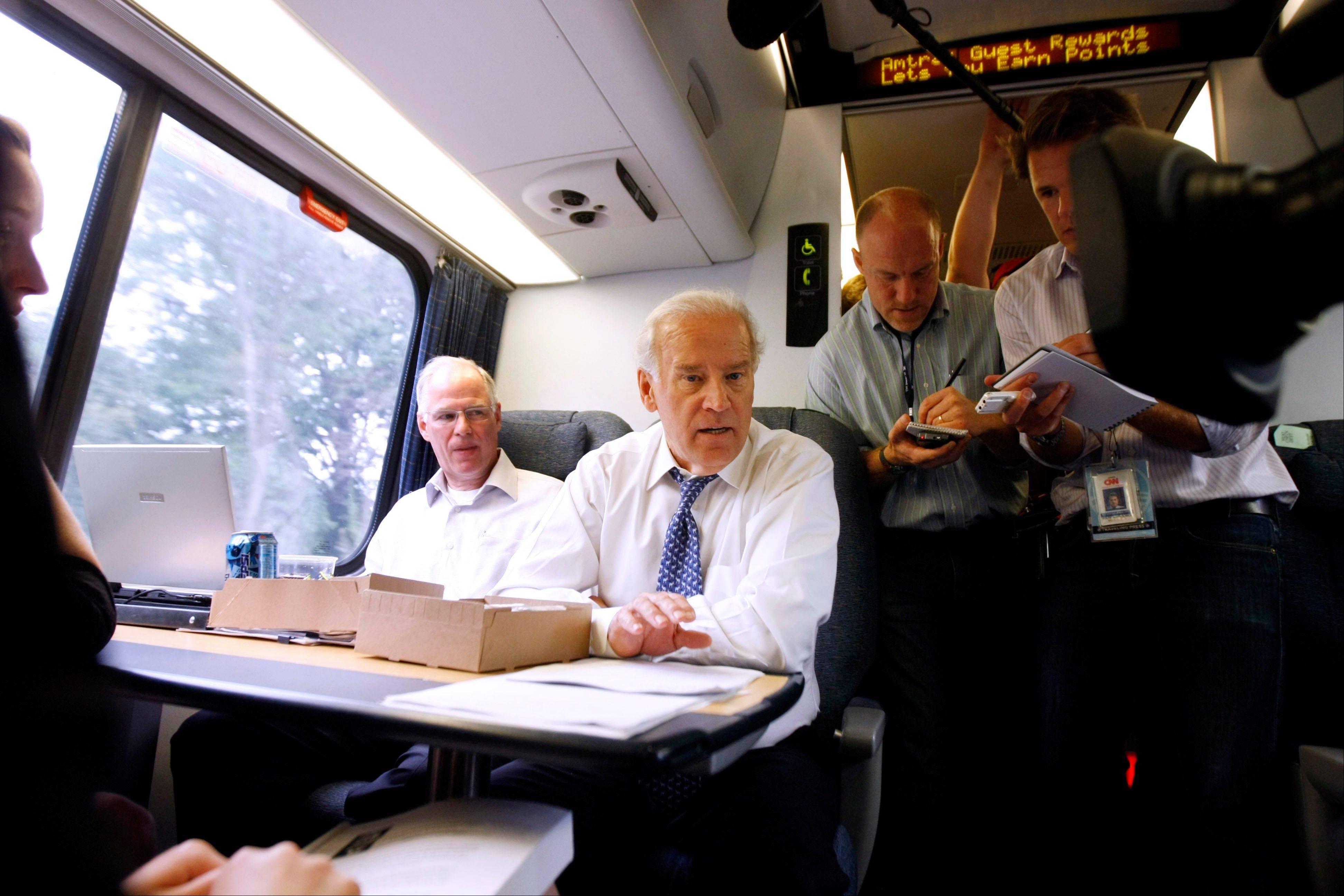 In this 2008 file photo, then-Democratic vice presidential candidate Sen. Joe Biden mingles with passengers aboard the Amtrak Acela train from Washington to Wilmington, Del. The platform Republicans adopted at their convention last week includes a call for full privatization and an end to subsidies for the nation's passenger rail operator.
