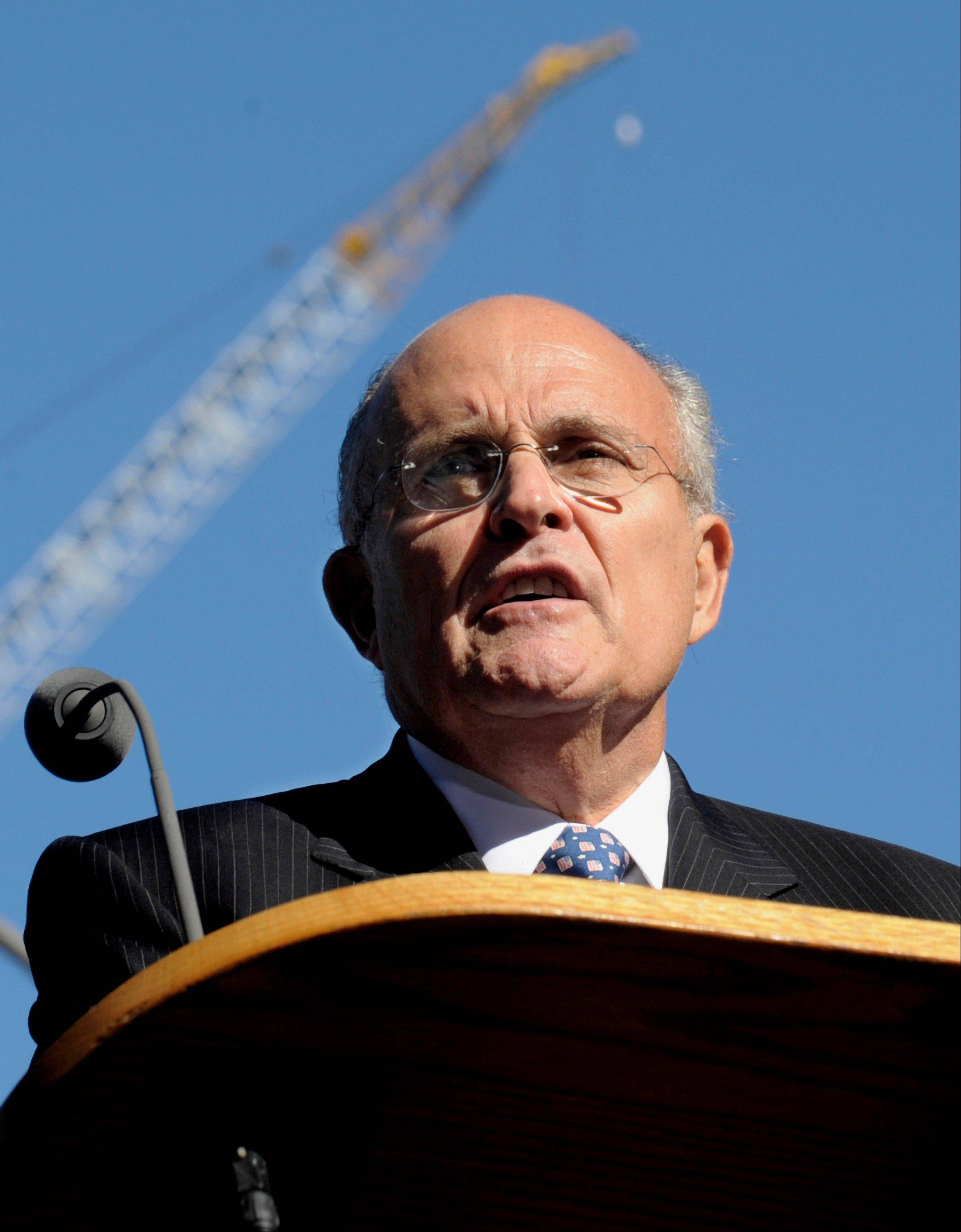 Former New York City Mayor Rudolph Giuliani reads a poem during a memorial service commemorating the ninth anniversary of the Sept. 11 terrorist attacks on the World Trade Center in New York i 2010.