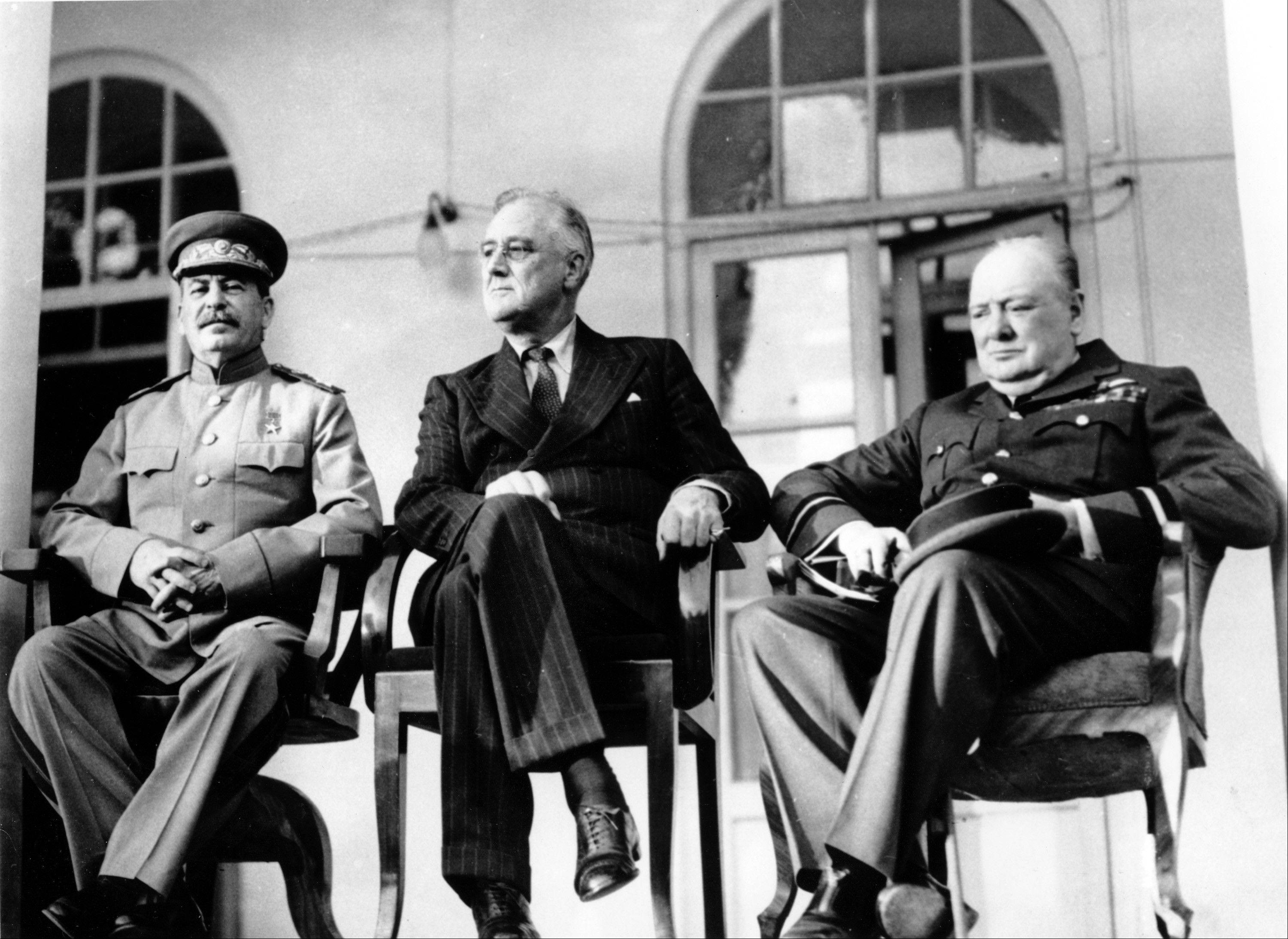 In this Nov. 28, 1943, file photo, Soviet Union Premier Josef Stalin, U.S. President Franklin D. Roosevelt, center, and British Prime Minister Winston Churchill sit together during the Tehran Conference in Tehran, Iran. The three leaders, meeting for the first time, discussed Allied plans for the war against Germany and for postwar cooperation in the United Nations.