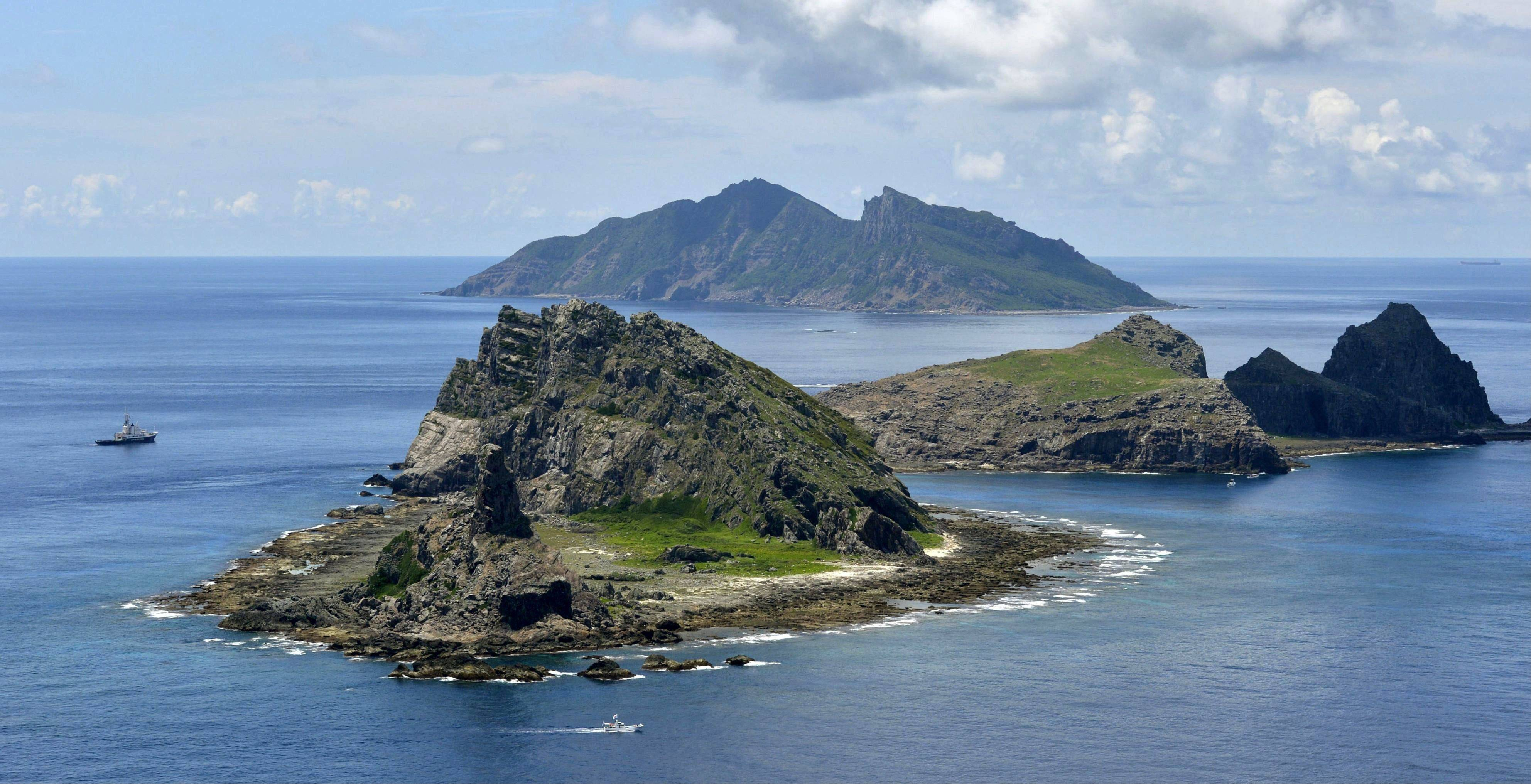 Japan's government says it has decided to purchase several disputed islands from their private owners in a step that is likely to anger China.