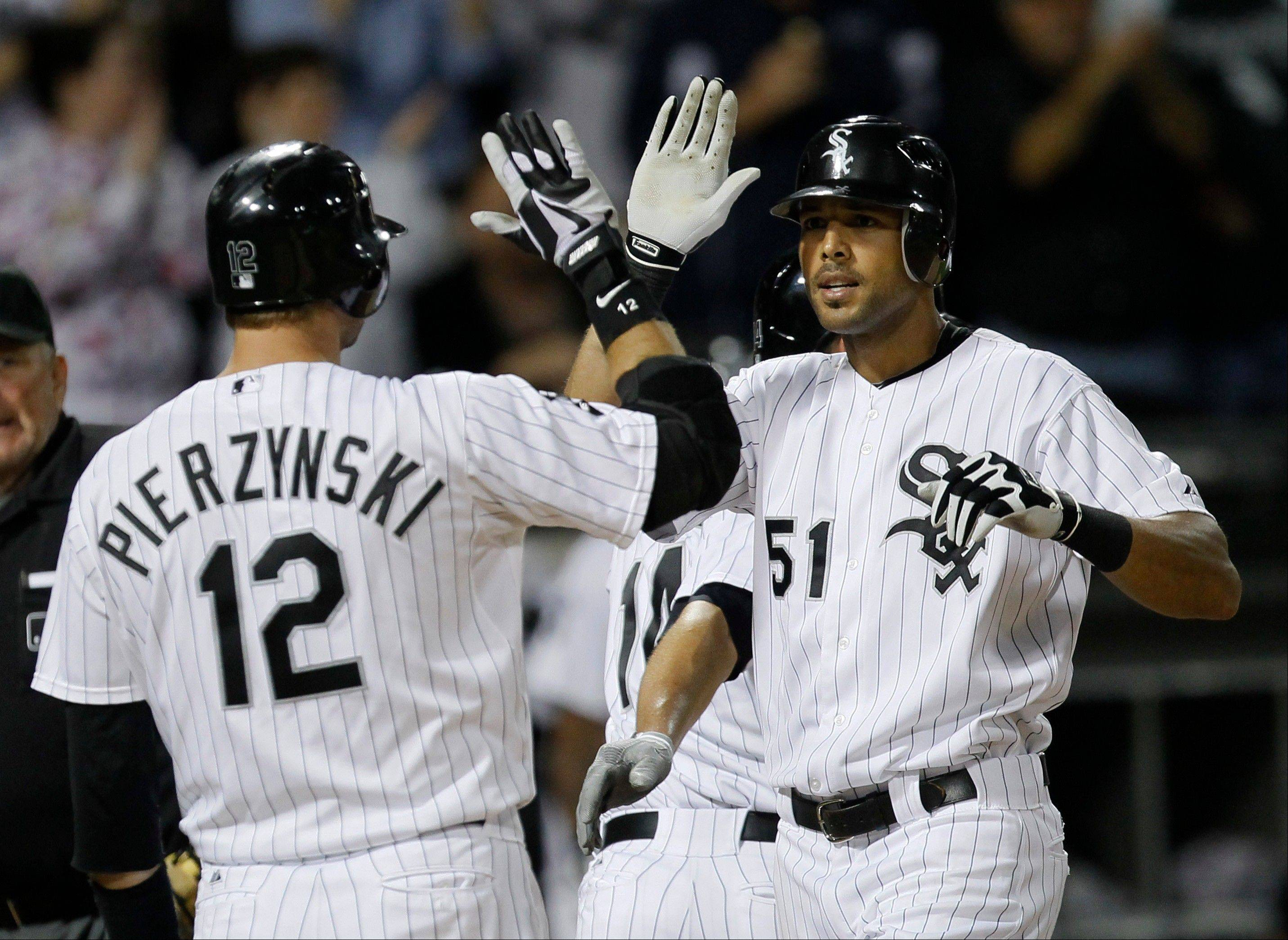Alex Rios is greeted at home by A.J. Pierzynski after Rios hit a 3-run home run off Detroit Tigers starting pitcher Rick Porcello on Monday night. Dewayne Wise and Paul Konerko scored on the sixth-inning homer. Pierzynski followed with a solo shot.