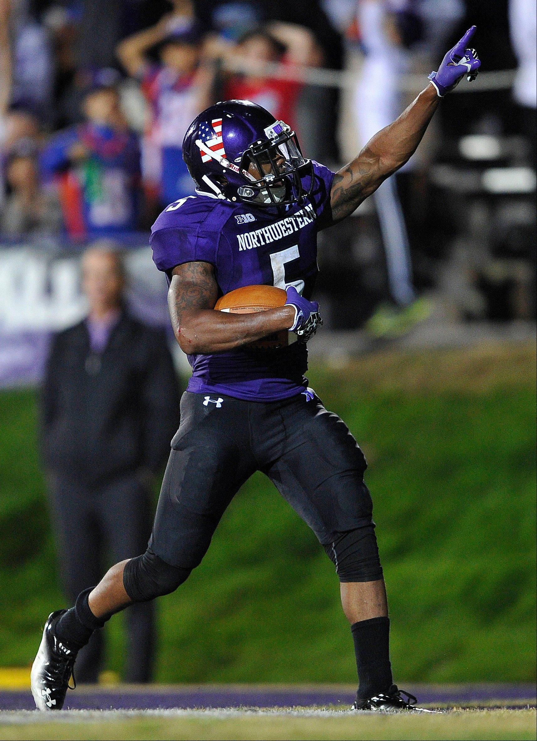 Northwestern�s Venric Mark celebrates a touchdown against Vanderbilt during the second half of the Wildcats� victory last Saturday.