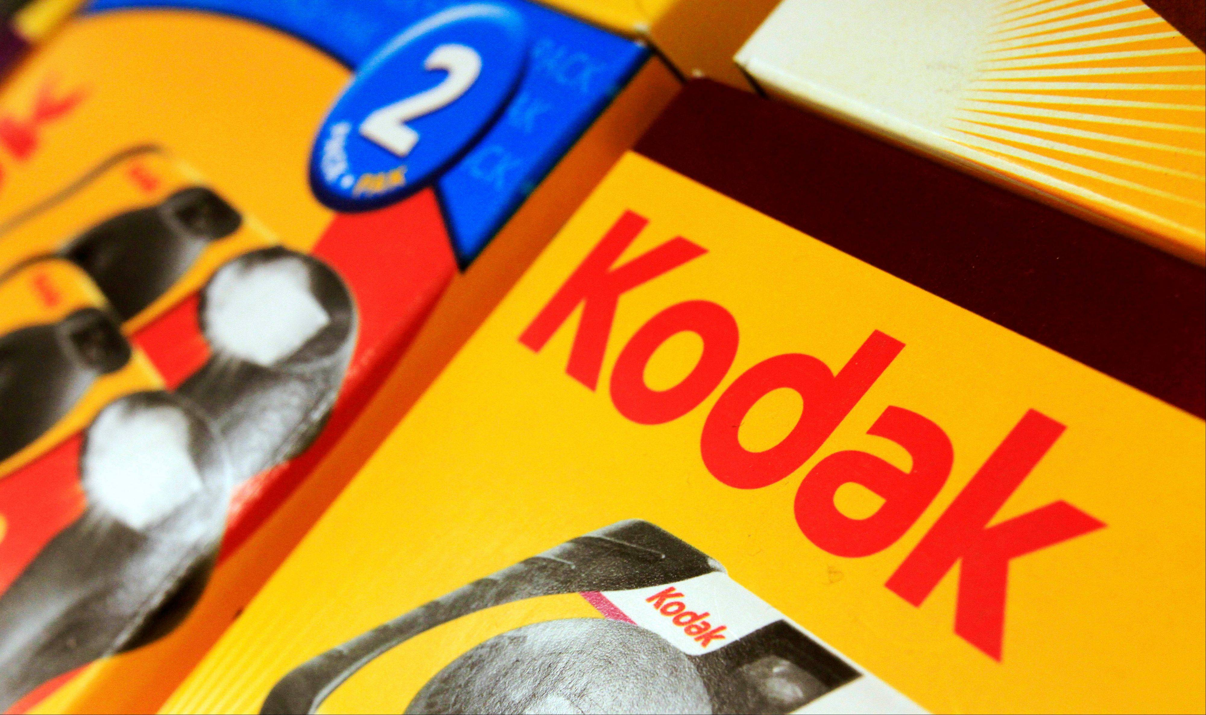 Kodak is reshuffling some executives and continuing to cut jobs as the pioneering photography company tries to emerge from bankruptcy protection.
