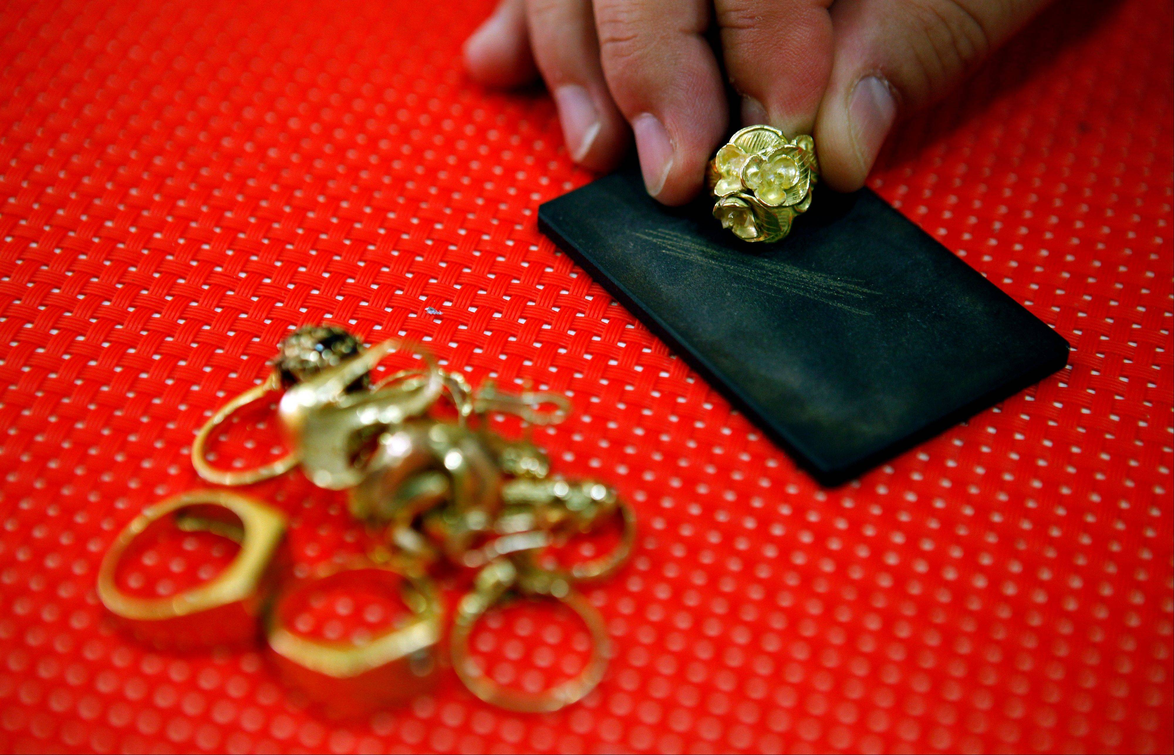 Gold, trading near a six-month high, may gain for a third day on speculation central banks from the U.S. to China will add to stimulus as economic data disappoints. Palladium rallied to the highest level in four months.