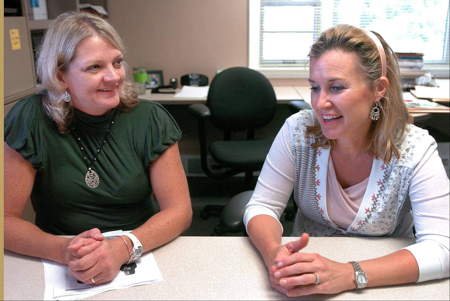 Janet VanZant of Deer Park, left, and Beth McAndrews of Barrington, talk about their jobs at the Village of Deer Park. They found their jobs with the help of CareerPlace in Barrington.