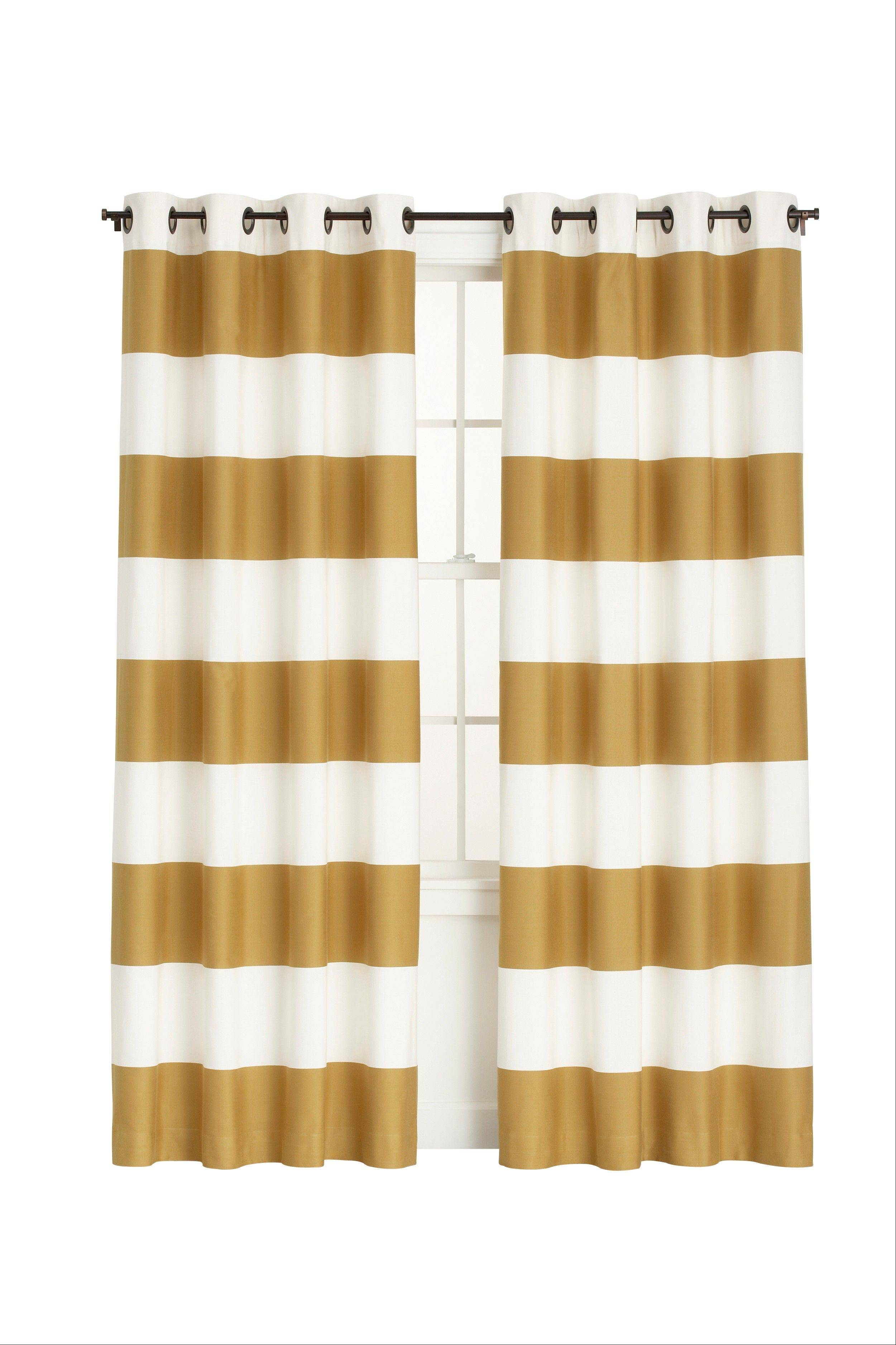 Bold ivory and gold stripe Aston curtains are shown. Available also in ivory and graphite, the curtains are in the top trend category for fall 2012.