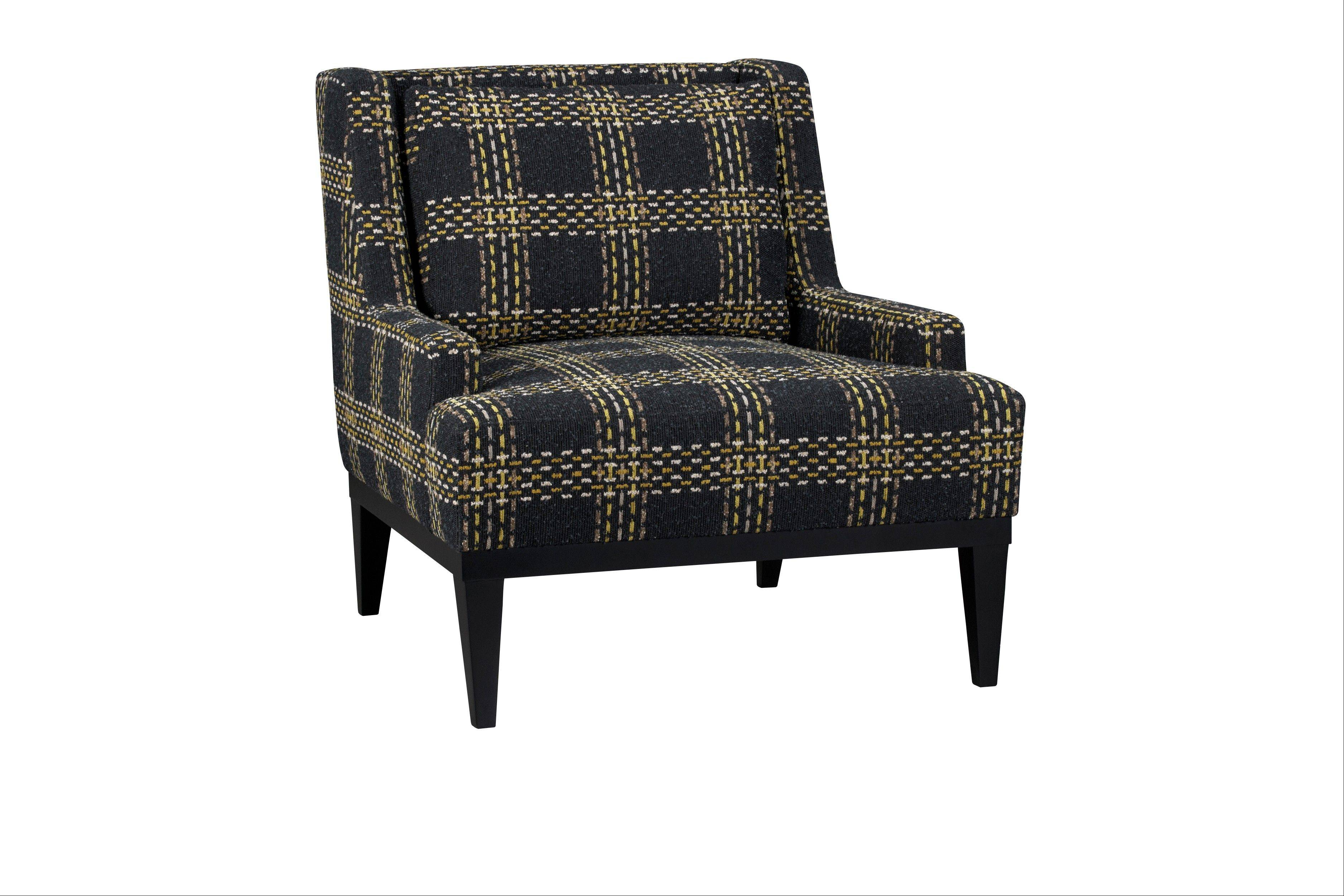 The nubby, retro plaid upholstery on a Donegal chair, part of a fall 2012 trend toward textured menswear fabrics, is shown.
