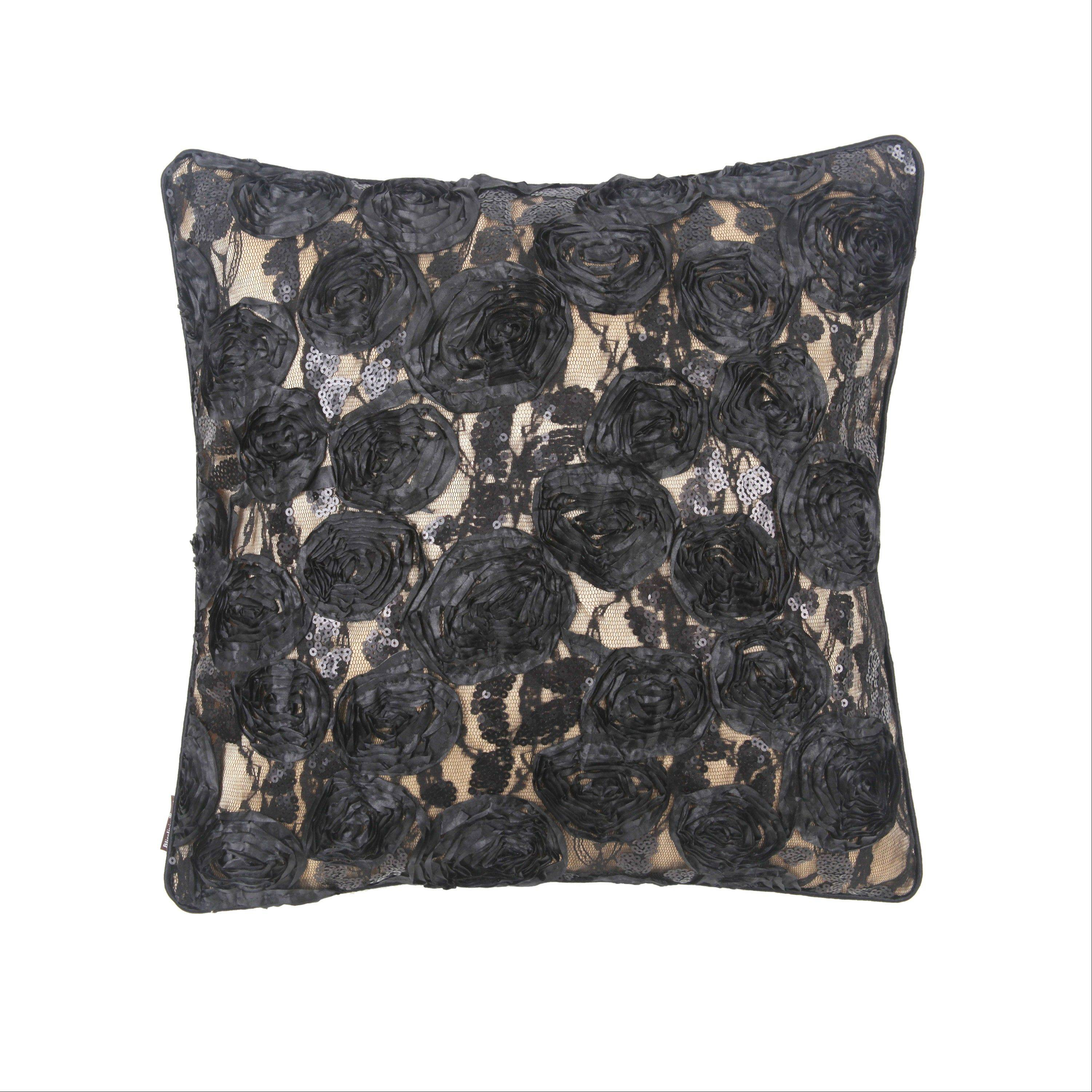 A saucy Sylvie lace pillow adds a touch of French savoir faire. Parisian style is a big fall trend.