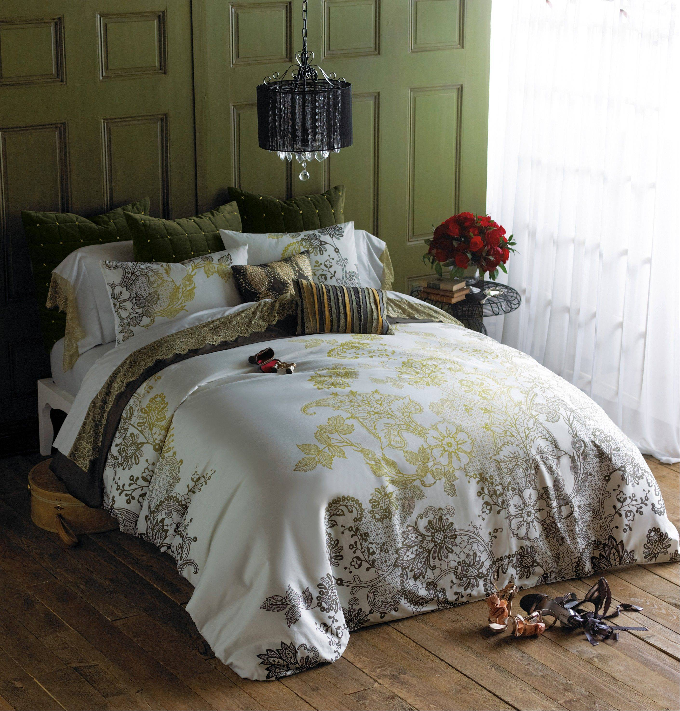 A lacy graphic in gold and graphite is shown on the Evita duvet set ($275.-295.), and a deep gold lace trims Tango sheets ($50.-135.) for a luxe, romantic bedding ensemble.