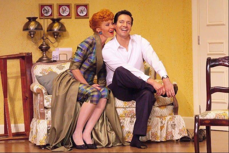 "Lucy (Sirena Irwin) and Ricky (Bill Mendieta) share a tender moment at home in ""I Love Lucy Live On Stage,"" which plays the Broadway Playhouse at Water Tower Place in Chicago from Wednesday, Sept. 12, through Sunday, Nov. 11."
