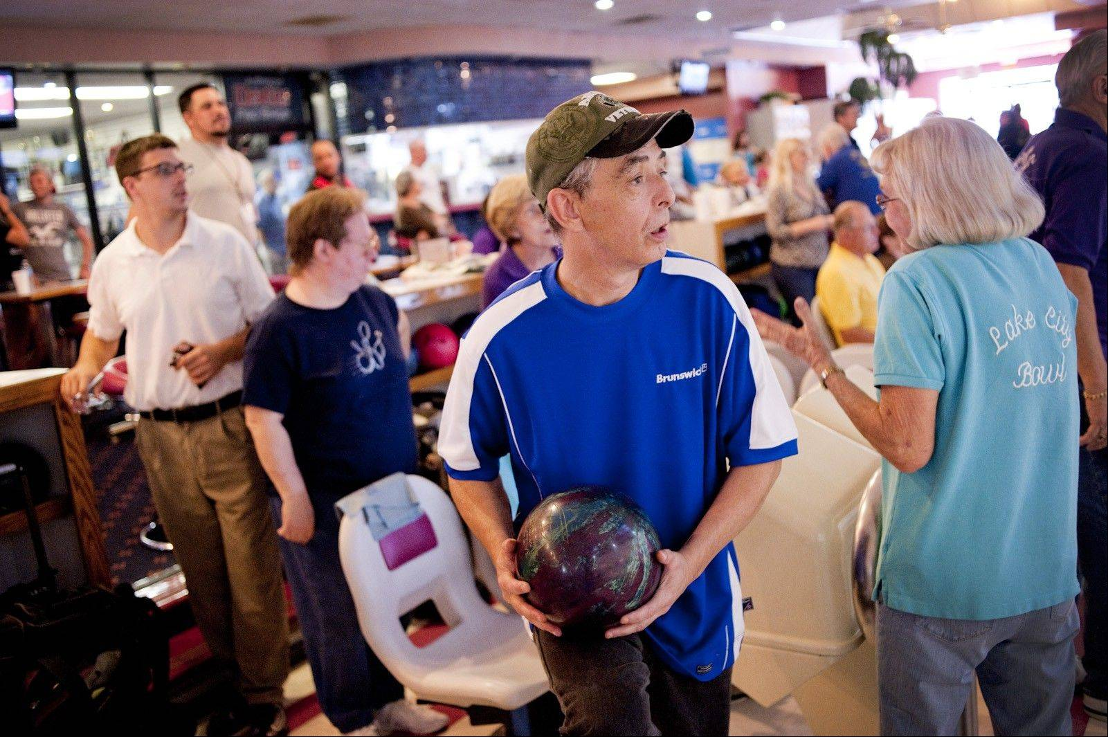 Henry Svetina is legally blind, but that does not deter him from his passion to bowl. Svetina paired up with some of his favorite pro bowlers during a recent Professional Bowlers Association Pro-Am event.